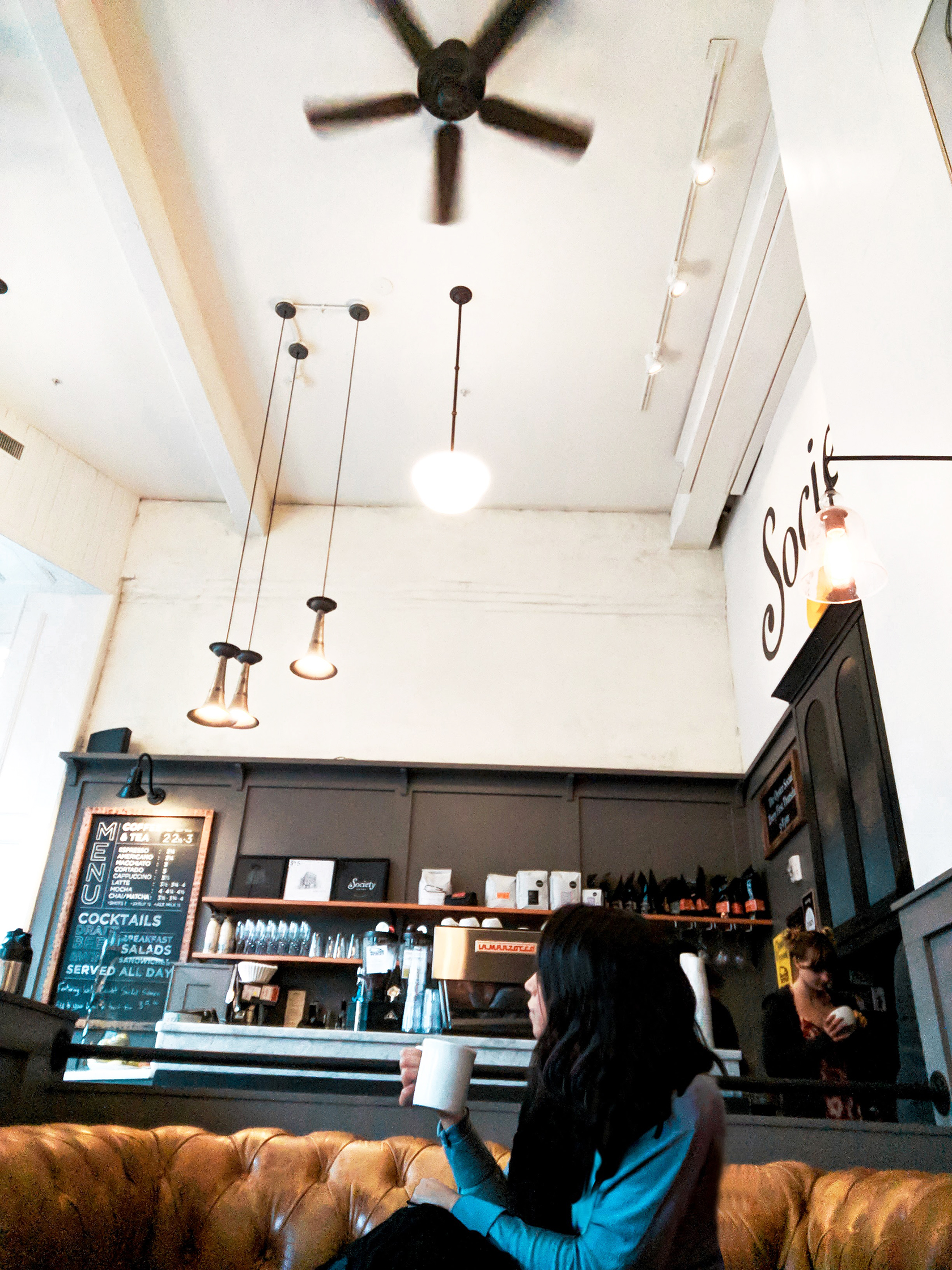 If you love cozy couches, warm, crackling fires, and amazing almond lattes, The Society Hotel cafe is the place you must go chill