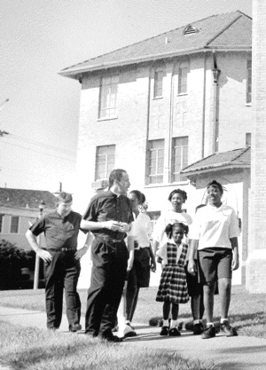 Fr. Tony Ricard and Fr. Harry Bugler walk with St. Rita school children around the church.