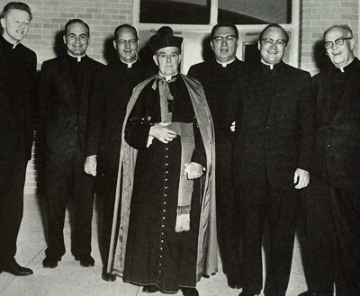 Msgr. William Castel, pastor of St. Rita Parish from -1958, is pictured with various priests who served with him during his pastorate.