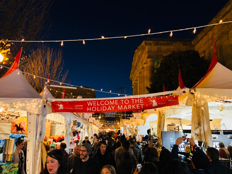evening-shopping-at-the-downtown-holiday-market_ddc-photo.jpg