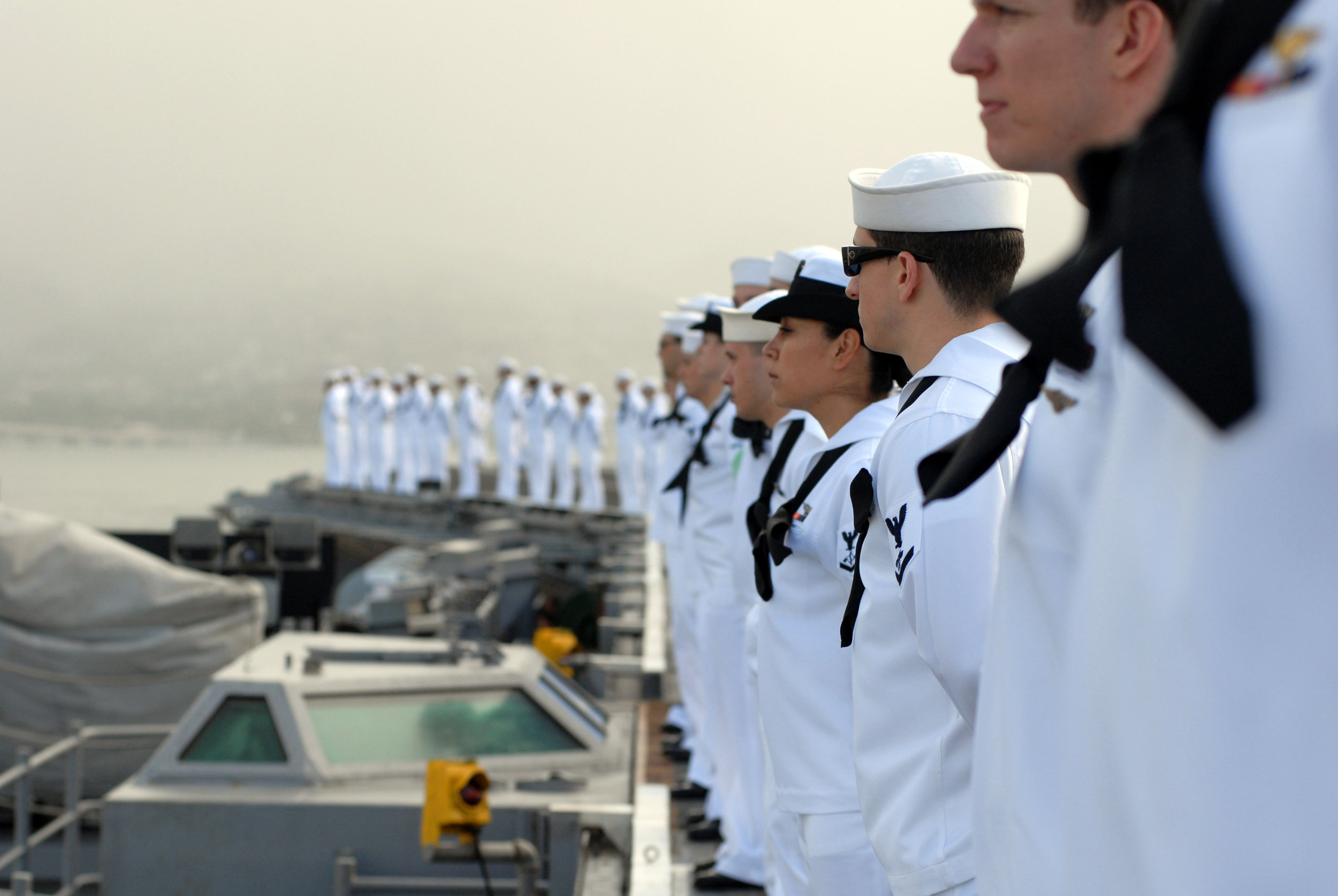 0420-0904-2711-4831_sailors_standing_around_the_deck_of_an_aircraft_carrier_o.jpg