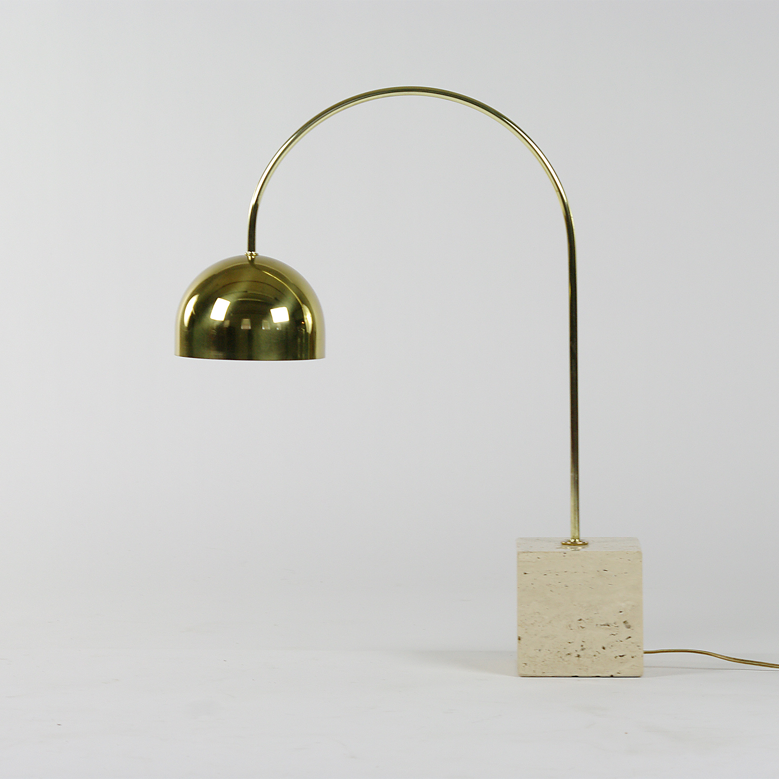 Brass and travertine table lamp by Harvey Guzzini - $800
