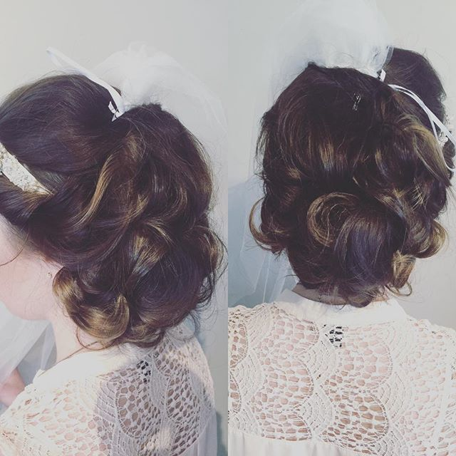 We love a bride #weddinghair #weddingseason #updo #behindthechair by @cheyennec007