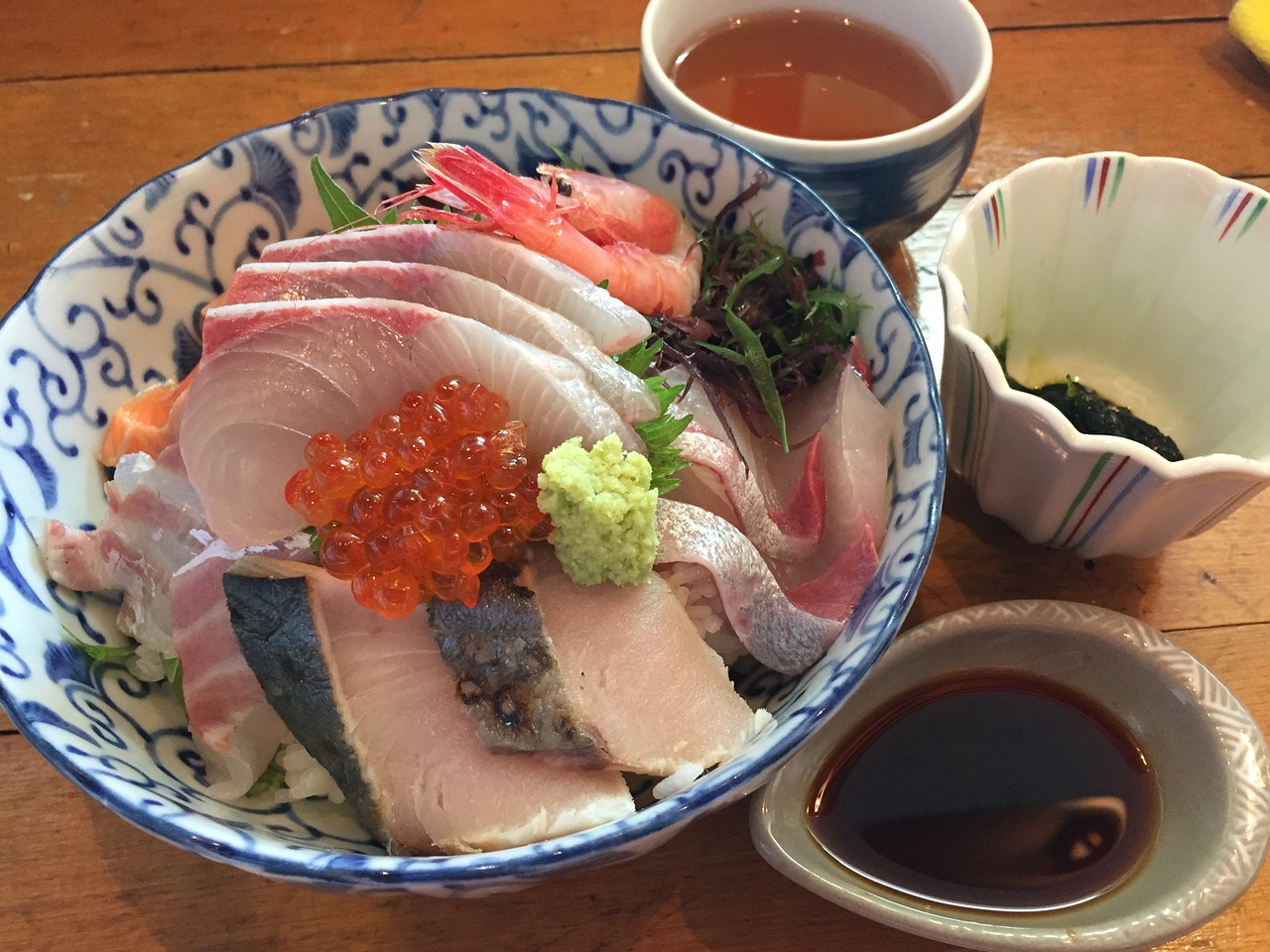 This is my go-to meal for fighting a cold. You can use any type of oily sashimi - salmon, salmon roe (pictured), mackerel, sardines, halibut (pictured), albacore tuna. This picture shows some red snapper too. The omega 3 from the fish is lubricating for the mucous membranes of the throat, anti-inflammatory and the protein content improves recovery from a virus.Depending on the thickness of the sashimi, adding raw fish to hot broth cooks it, so add it last minute as the goal is to have it as rare as possible.  The second step is to chop up available spicy and pungeant veggies such as radish, daikon, watercress, mustard greens, arugula, radish,mustard or broccoli sprouts, broccolini, cabbage, nasturtium leaves/flowers, onions, leeks, ginger, garlic, hot peppers, jalapenos peppers,black pepper, white pepper and a big dollop of horseradish or japanese horseradish, known as wasabe (pictured).   These veggies provide good clearing of mucous, as do all the peppery veggies. Plus they help to increase a fever, which deactivates a virus. Immune mushrooms such as shitake are also excellent in this soup for immune boosting properties. The spicier the better, as long as you can enjoy it.  The last step is to pour the broth - I use whatever broth I have around - it could be the  potassium broth , chicken broth, veggie broth or  dashi .  Ingredients: Serves 1 (needs to be prepared fresh each time, as cooked veggies lose their mucous fighting properties)  1 cups of your favorite home-made stock  1/2 pound of the freshest sushi grade oily fish you can get (from a fish market, or sushi takeout restaurant)  1/4 cup fresh shitake mushrooms, or reconstituted dried ones- finely chopped  1/3 cup chopped watercress  1/2 tsp finely chopped chili pepper (if not avoiding nightshades)  1 T chopped Scallions  1 teaspoon of finely chopped ginger  1/2 tsp of wasabi or horseradish  1 lemon wedge  1 T chopped cilantro  Other vegetables (radish, daikon, chopped garlic, etc)  Directions:  Bring broth