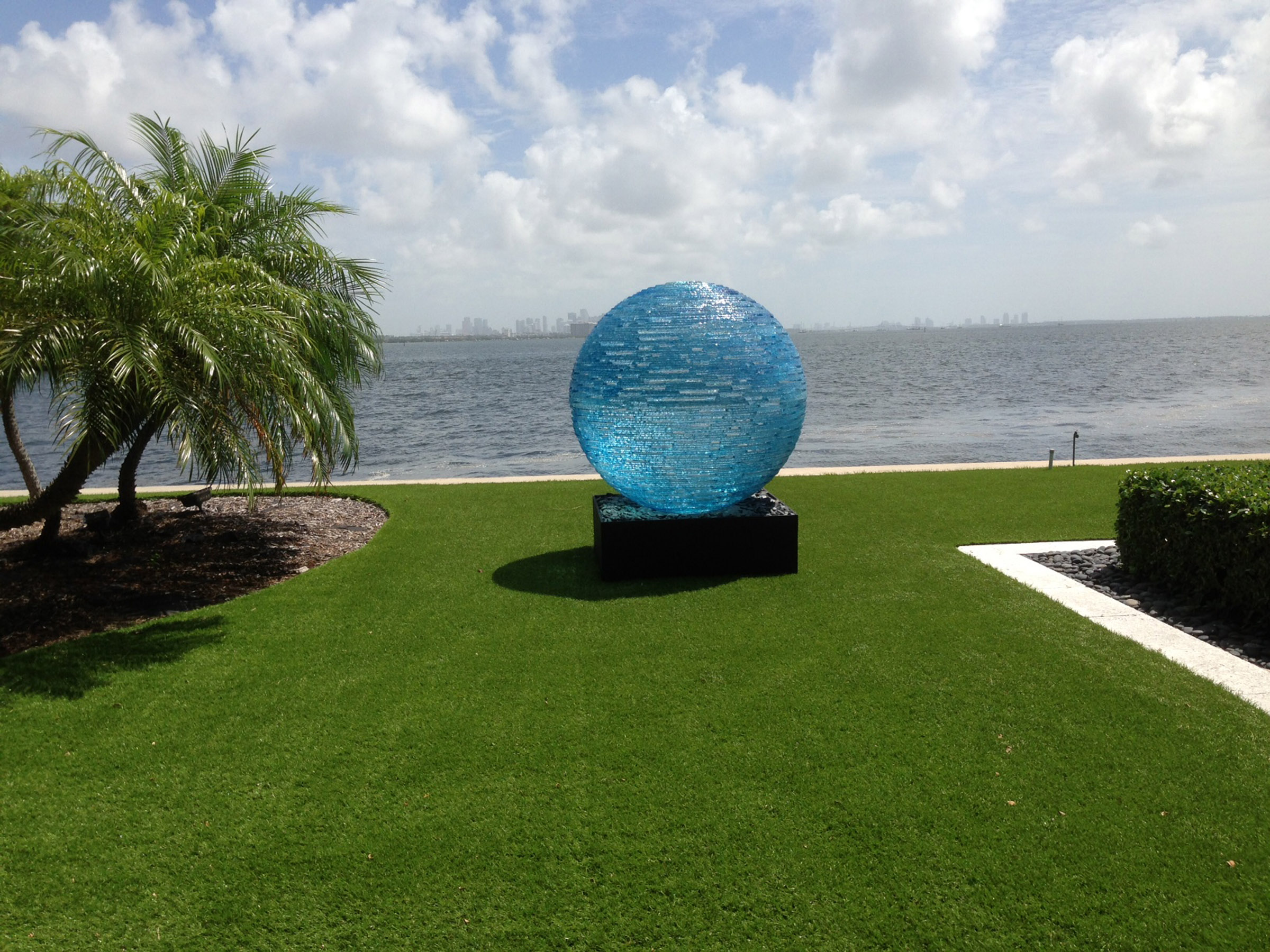 Henry-Richardson--blue-glass-orb-sculpture-by-the-sea-in-garden-landscape-setting.jpg