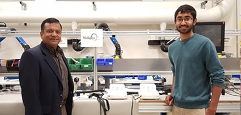 From left to right: Samuel Prabhakar, Founder of Elite Custom Solutions and SciTechsperience intern and University of Minnesota student Sachchit Murali.