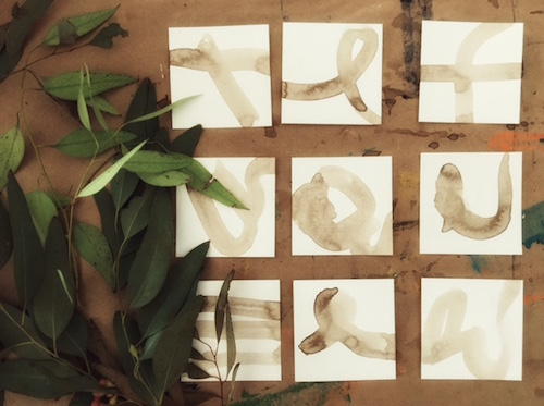 Squares with walnut ink, ready for printing with eucalyptus leaves.