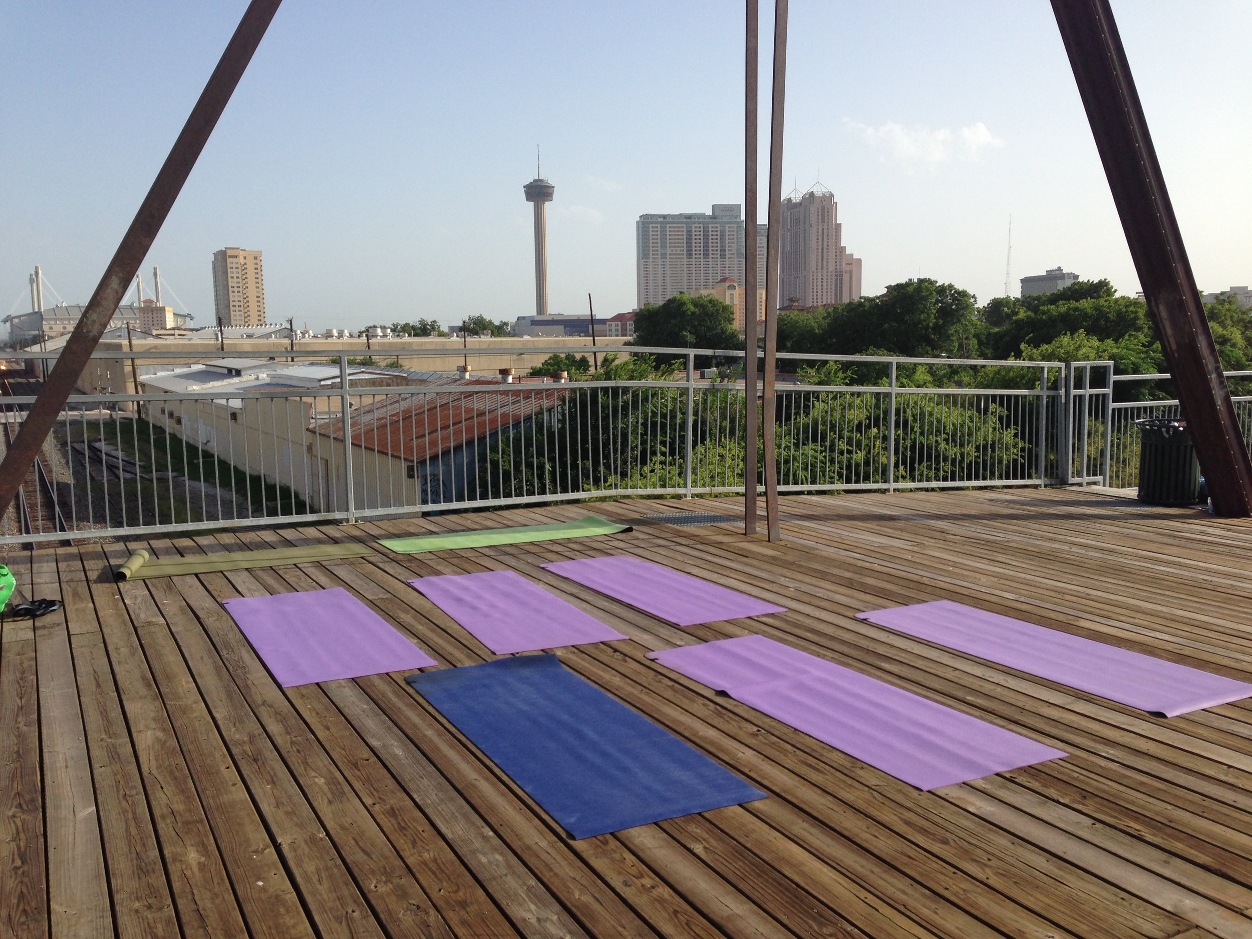 Yoga mats unrolled in preparation for the first Mobile Om class on the Hays Street Bridge on June 21, 2013.