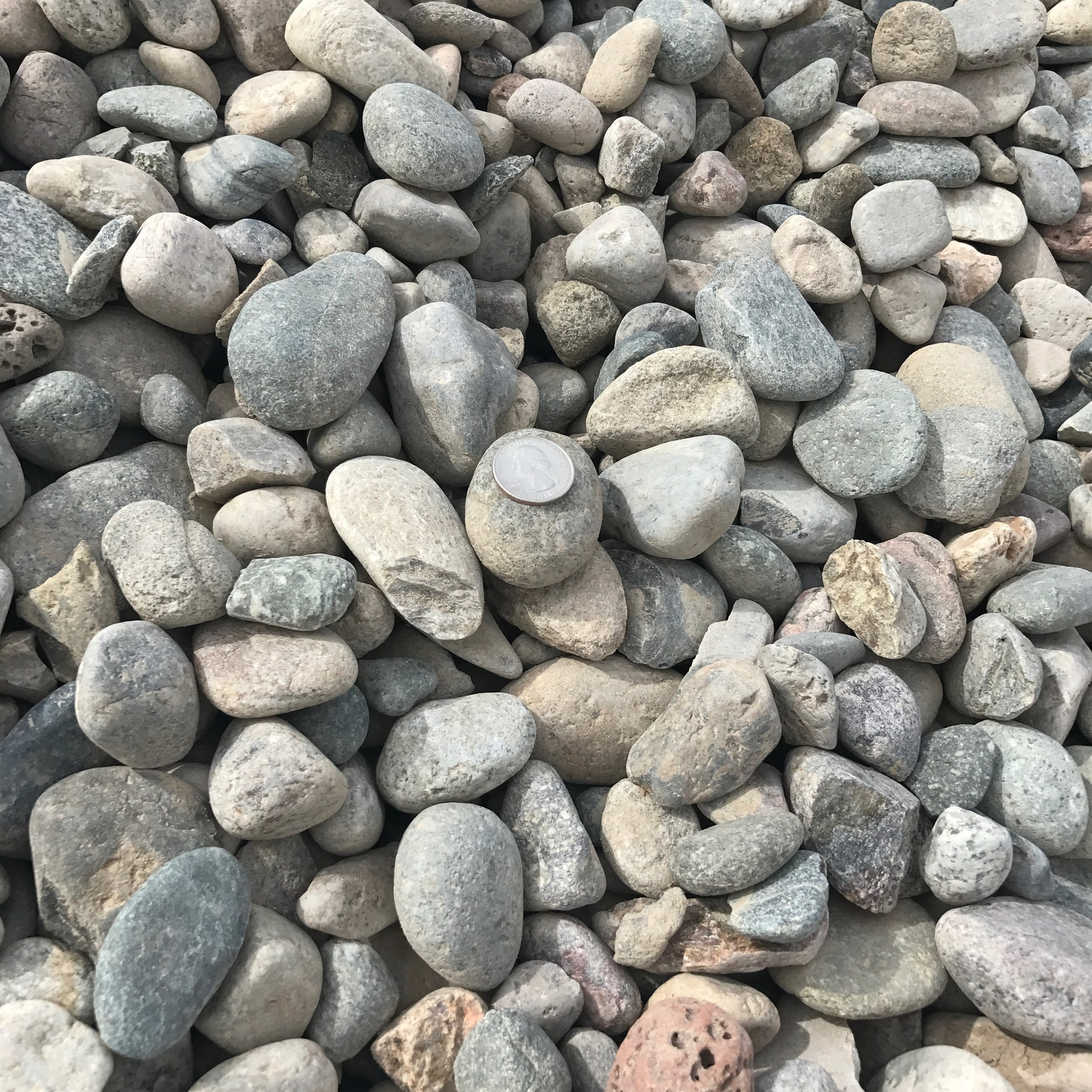 """2"""" Round   Round rock used for landscaping or drainage backfill"""