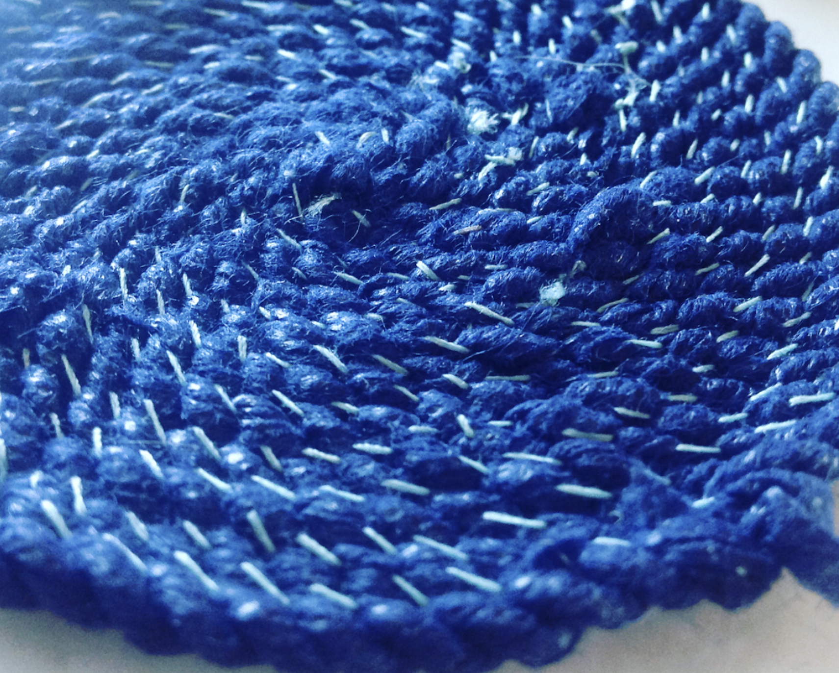 """Since learning last year how to make string from remnant clothing, I have been experimenting using this technique using disposable medical garments. This is a close-up of a piece I'm creating borne from the growing concern of the amount of textile waste being created from our society's addition to fast fashion. If this is of concern to you to, I highly recommend purchasing a copy of """"Loved Clothes Last"""" - the second fanzine produced by UK based  Fashion Revolution ."""