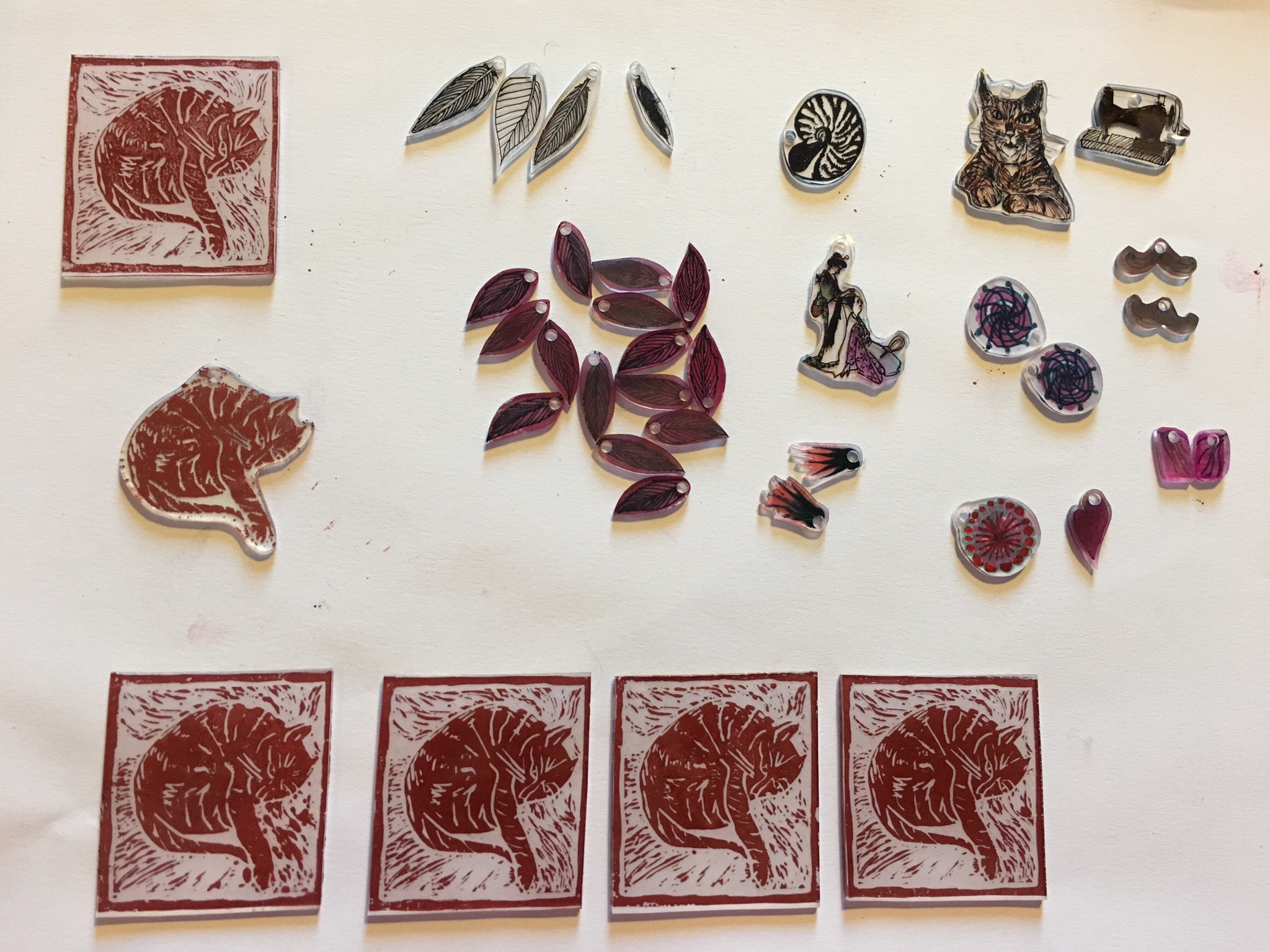 Experiments in shrinkable plastic - with drawing and lino printing