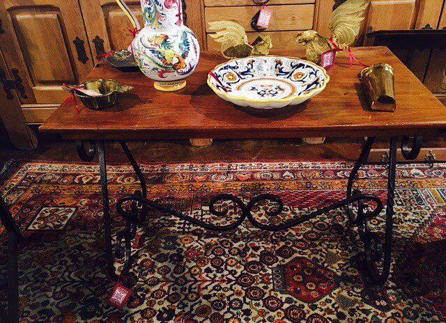French side table of walnut & forged iron base.... beautiful lines! $500 2195 Calder Ave, Beaumont Tx, 77701, 409.835.3080  #vintagepaint  #burnsantikhaus  #europeanimporters #burnsantikhaus  #vintagefinds #europeanimporters  #beaumont  #antiques  #european  #imports  #treasures  #setx  #vintage  #handpicked  #local  #interiordesign  #salvage  #shop  #across  #texas #burnsantikhaus  #shoplocal  #buy  #follow