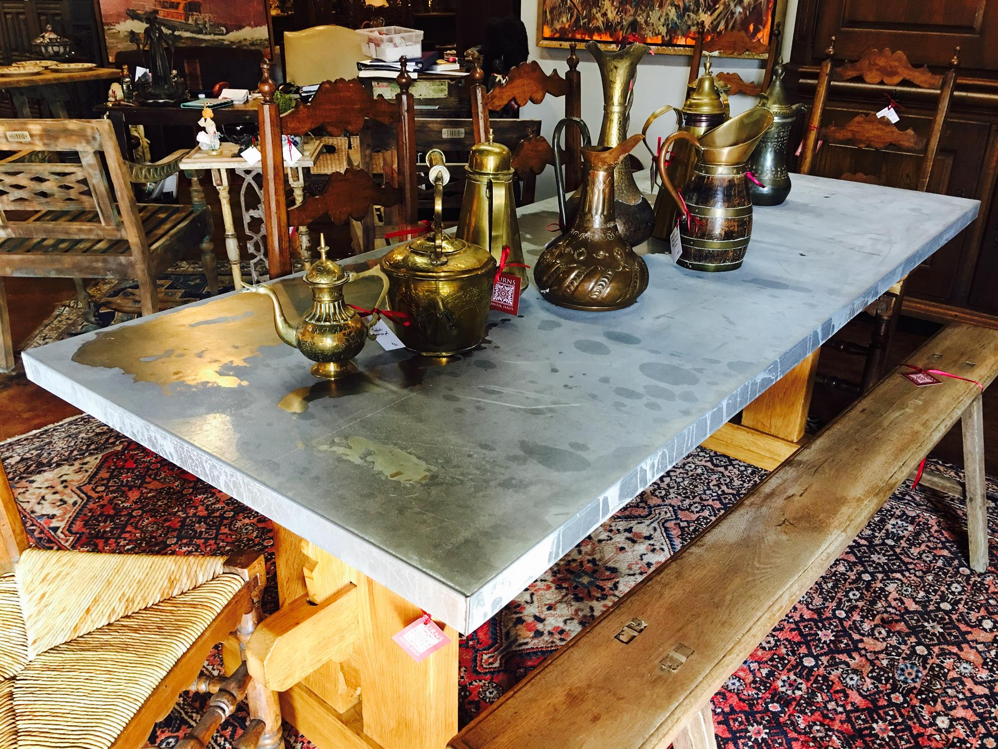 Just arrived, Zinc Topped Table and a collection of brass and copper teapots!!! Come check us out! 2195 Calder Ave, Beaumont Tx, 77701, 409.835.8030.  #burnsantikhaus  #vintage  #europeanimporters  #shopsmall
