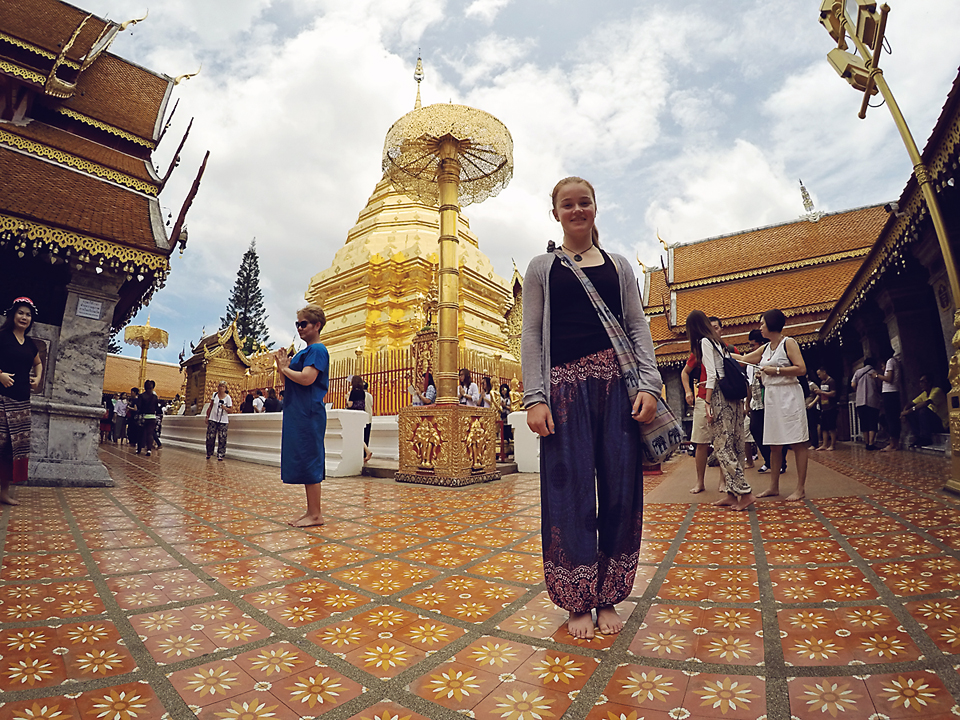 Summer and James went to visit Wat Phra That Suthep . 300 and something steps to an amazing temple and lookout.