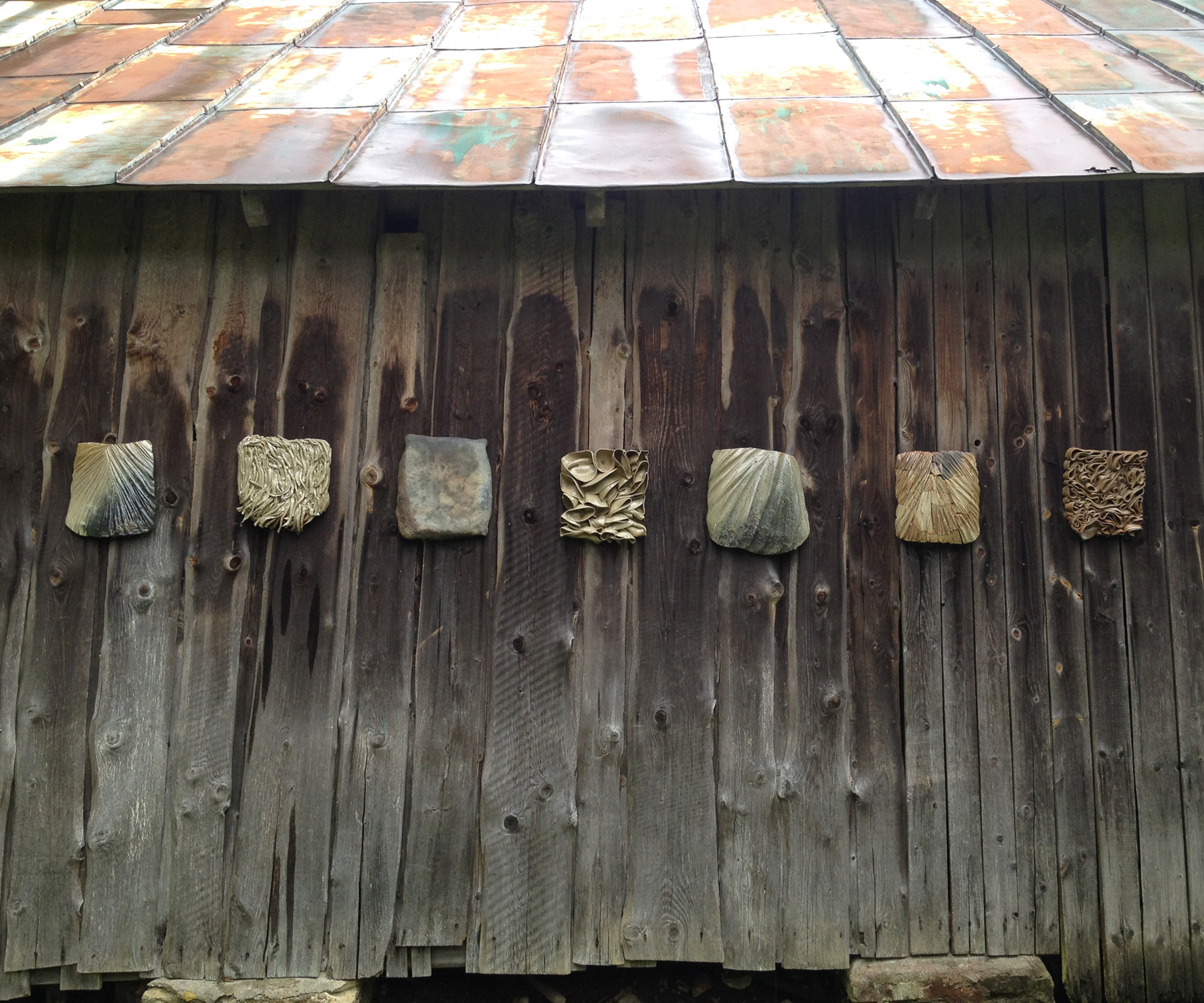 Texture Studies 1-7, wheel thrown and hand build wall hanging objects, wood fired in Anagama kiln.
