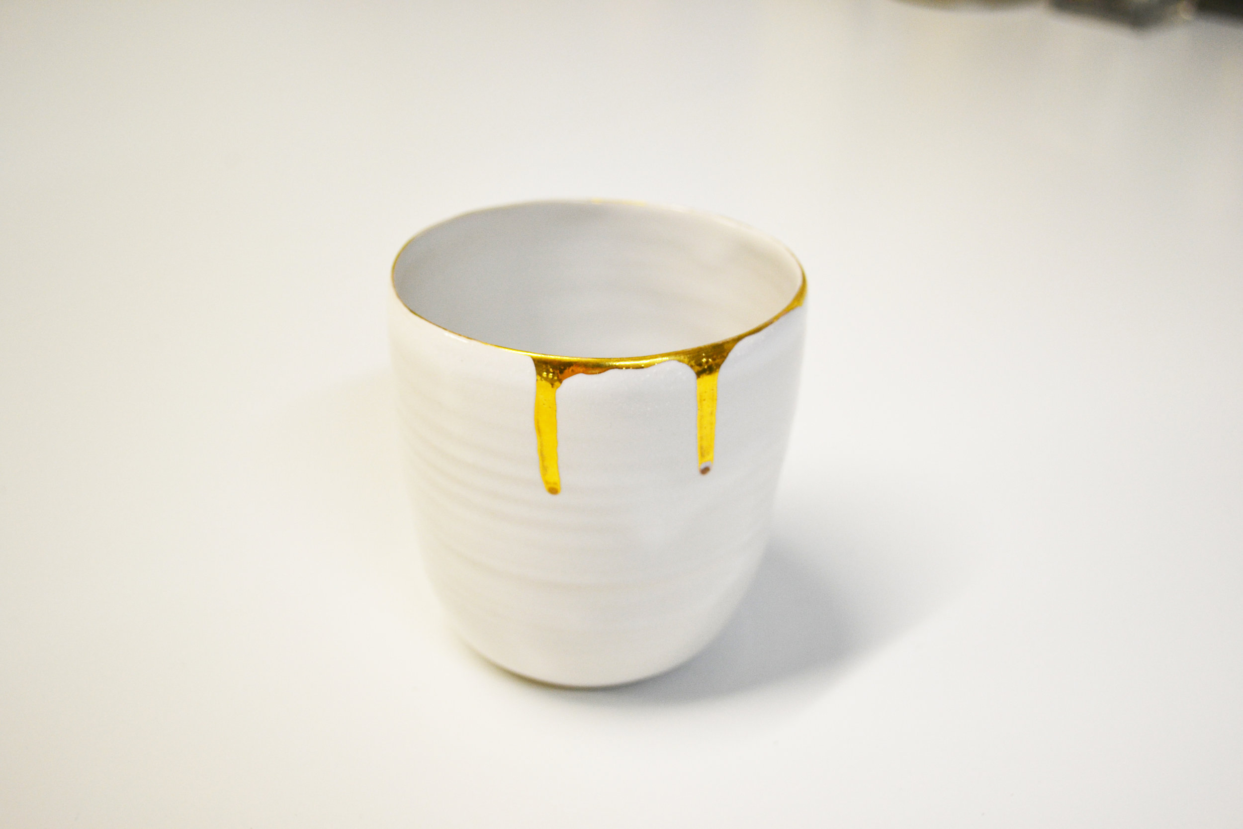 Liquid gold tableware, size - 35 cl, material - stoneware ceramics, technique - wheel thrown, decorated with liquid gold, year - 2016, place - Helsinki, Finland