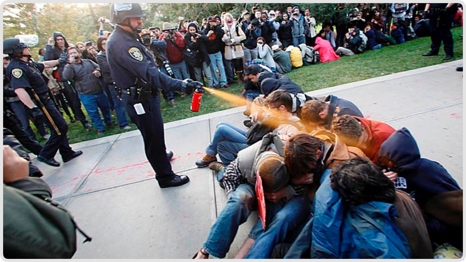 Demonstrators, protesting the shootingdeath of Michael Brown,scramble for cover as police fire tear gas.