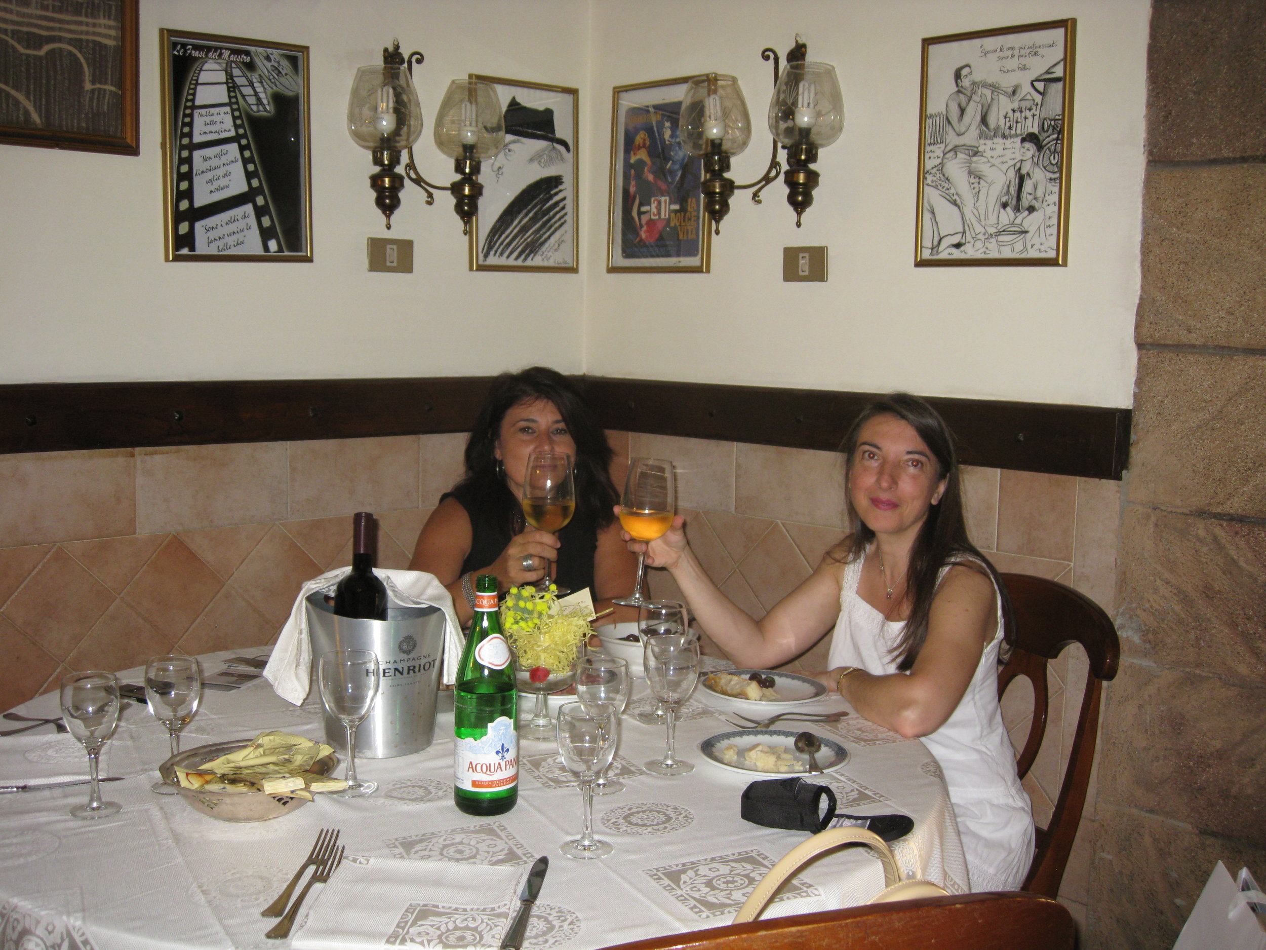 STEFANIA WITH THE OWNER OF THE RESTAURANT IN ROME AT FEDERICO FELLINI'S TABLE WHERE THE FILM MAKER USED TO HAVE DINNER FREQUENTLY WITH HIS FRIENDS SOPHIA LOREN AND MARCELLO MASTROIANNI.