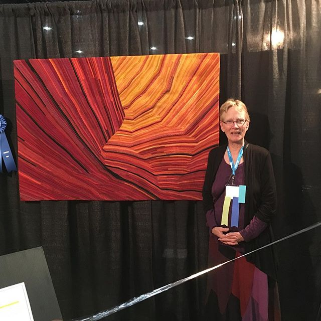 Fire in the Stone just won blue ribbon in Houston IQA show. Wow! So honored! #artquilts #coyotebuttes #silkquilts #sandstone