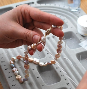 Pearl   restringing   Don't leave that broken strand lying in a heap in your jewelry box. Bring it by for a professional restringing so you can wear those beauties!