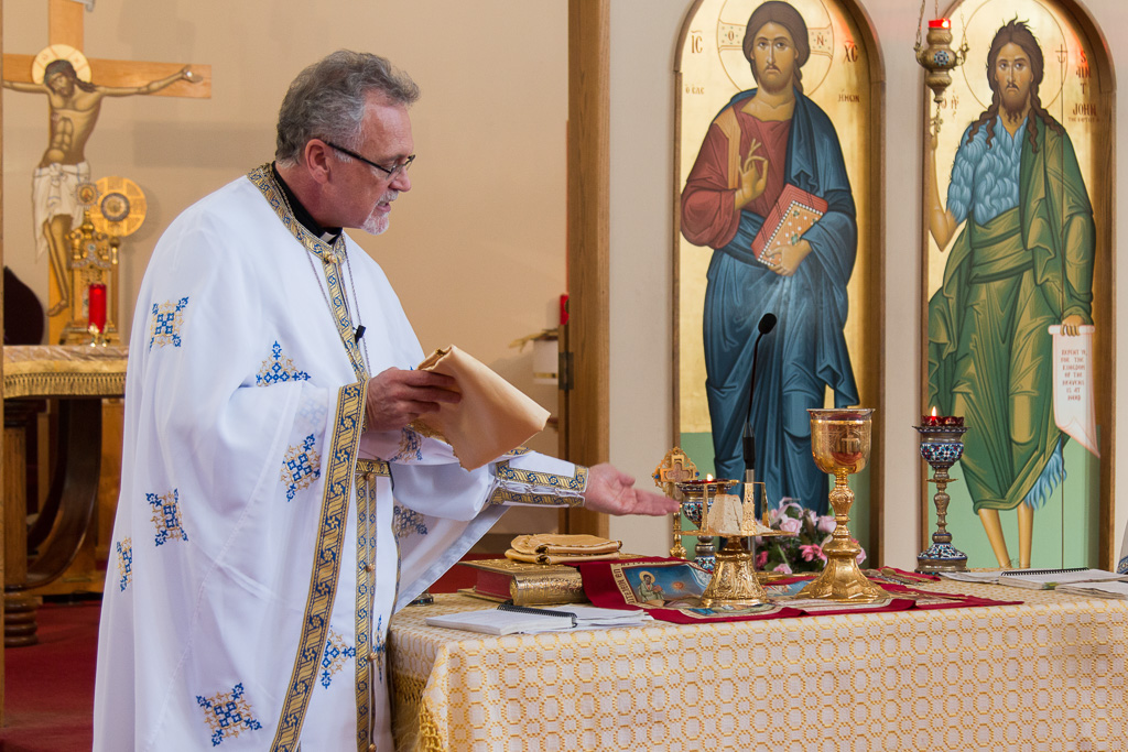 The altar is normally behind the icon screen. Twice a year Fr Lou performs a teaching liturgy out front to demonstrate the preparation of the eucharist.