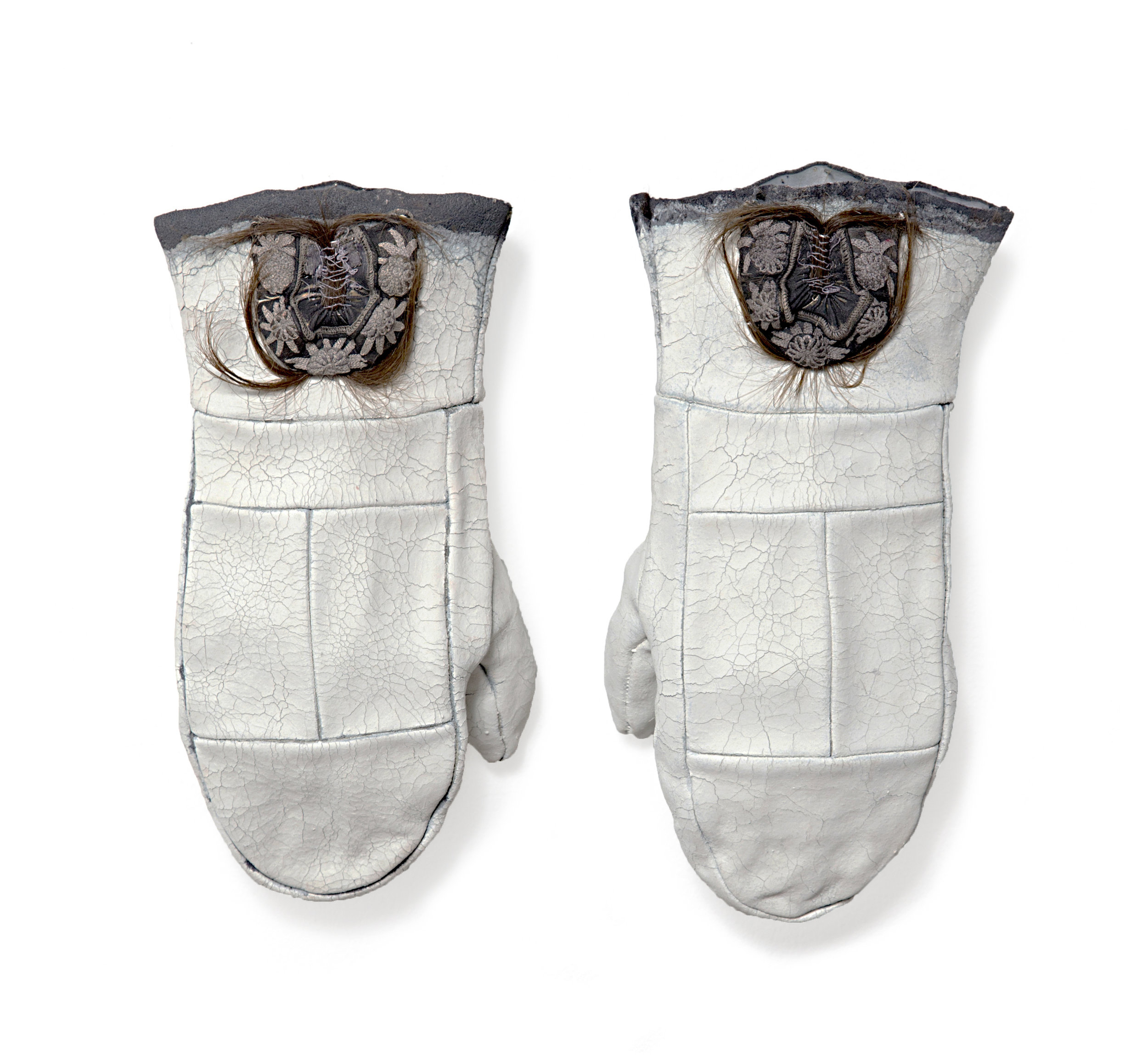 """untitled mittens , leather, milk paint, hair, 11""""x6""""x2.5"""" each, 2016"""
