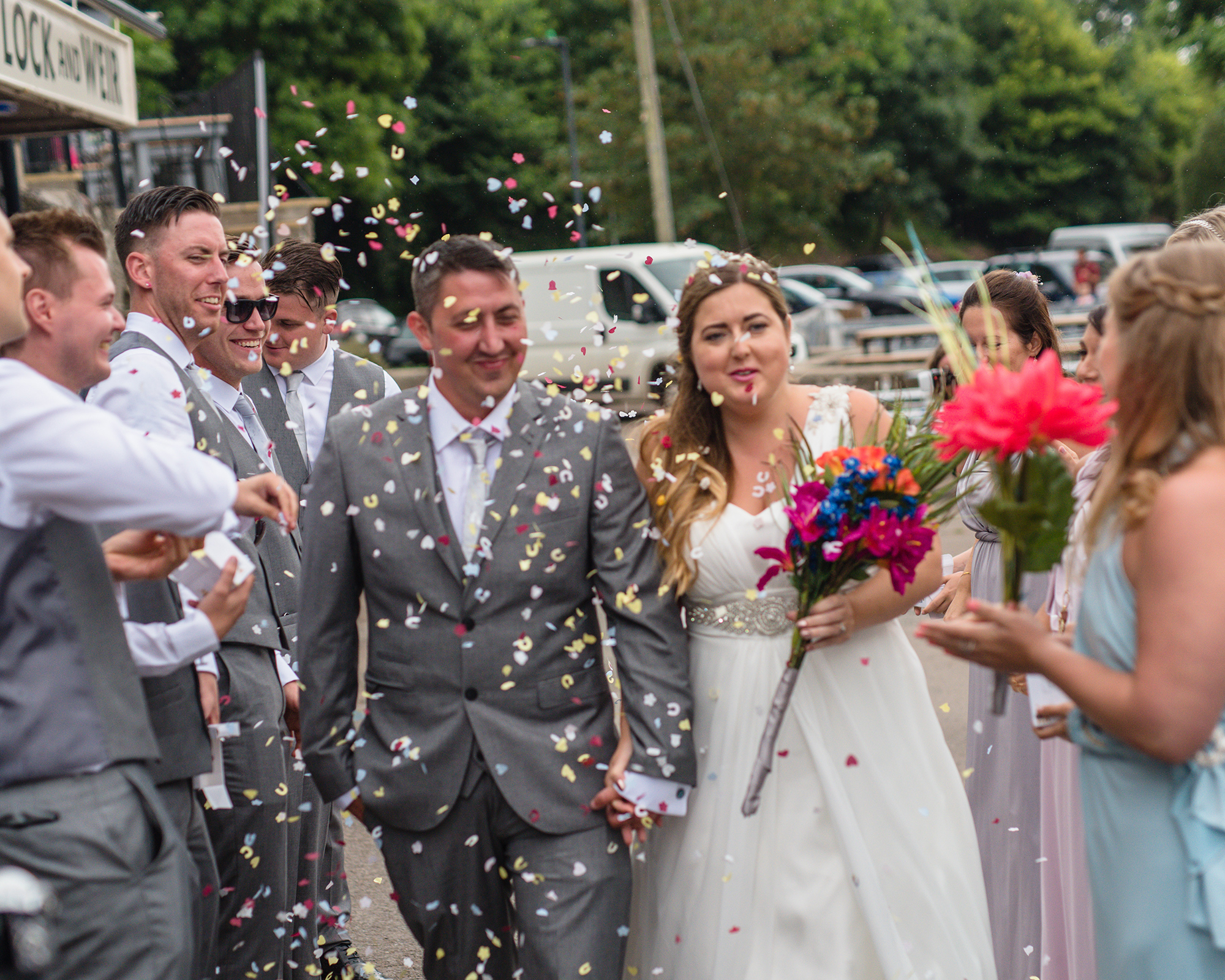Confetti showers for the new Mr & Mrs at their Bristol UK wedding reception