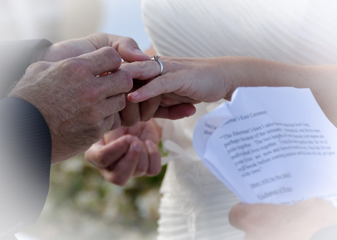 Groom places ring on brides ring finger, Ponte Vedra Inn and Lodge, Florida