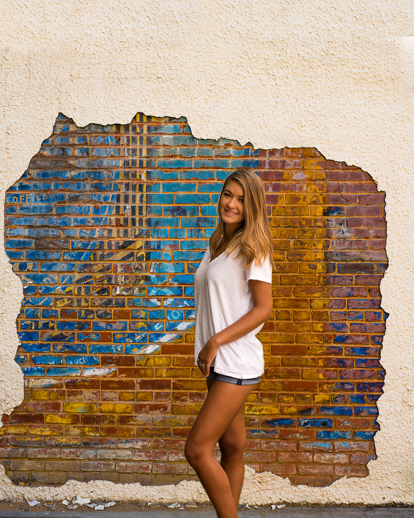 Senior portrait by graffiti wall in Marietta Georgia