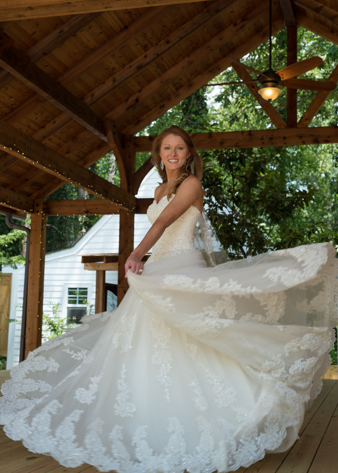 Kennesaw GA Bride twirling with dress at wedding