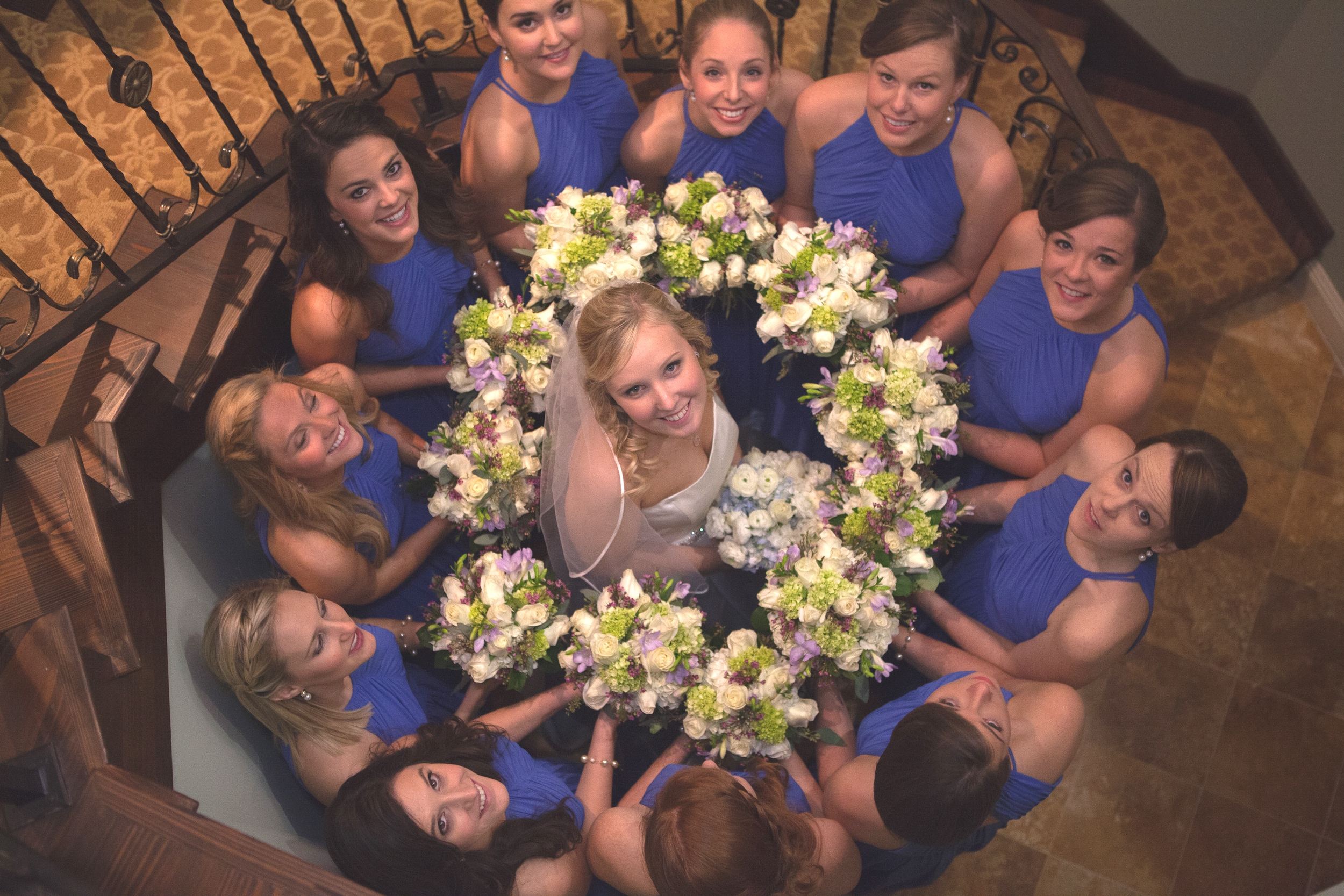 Bride surrounded by flowers, friends and love destination wedding at Ponte Vedra Inn, Florida