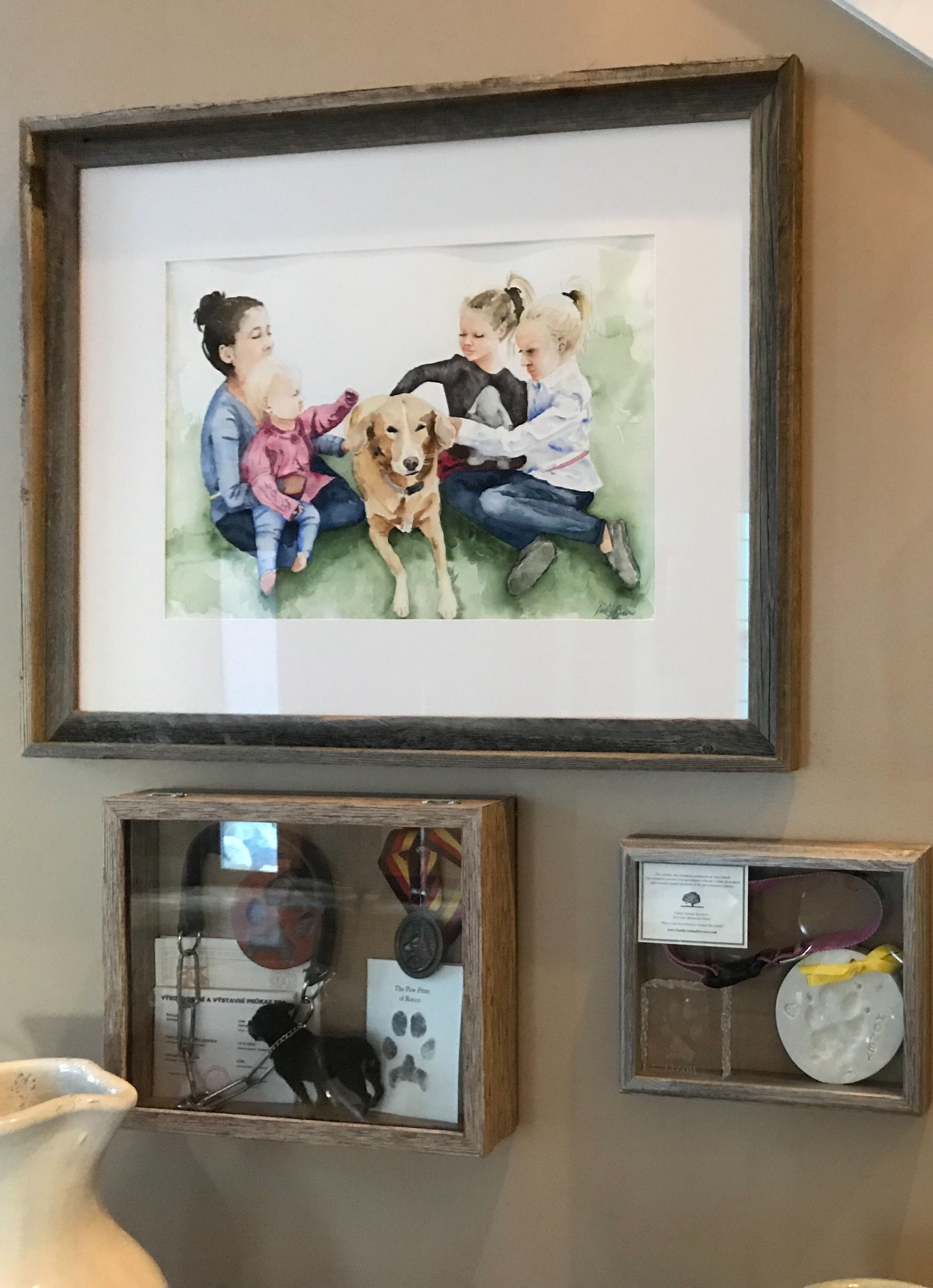 Honey Love ©PamBaumeister,2017 on the wall with other mementos of the family and their dog.