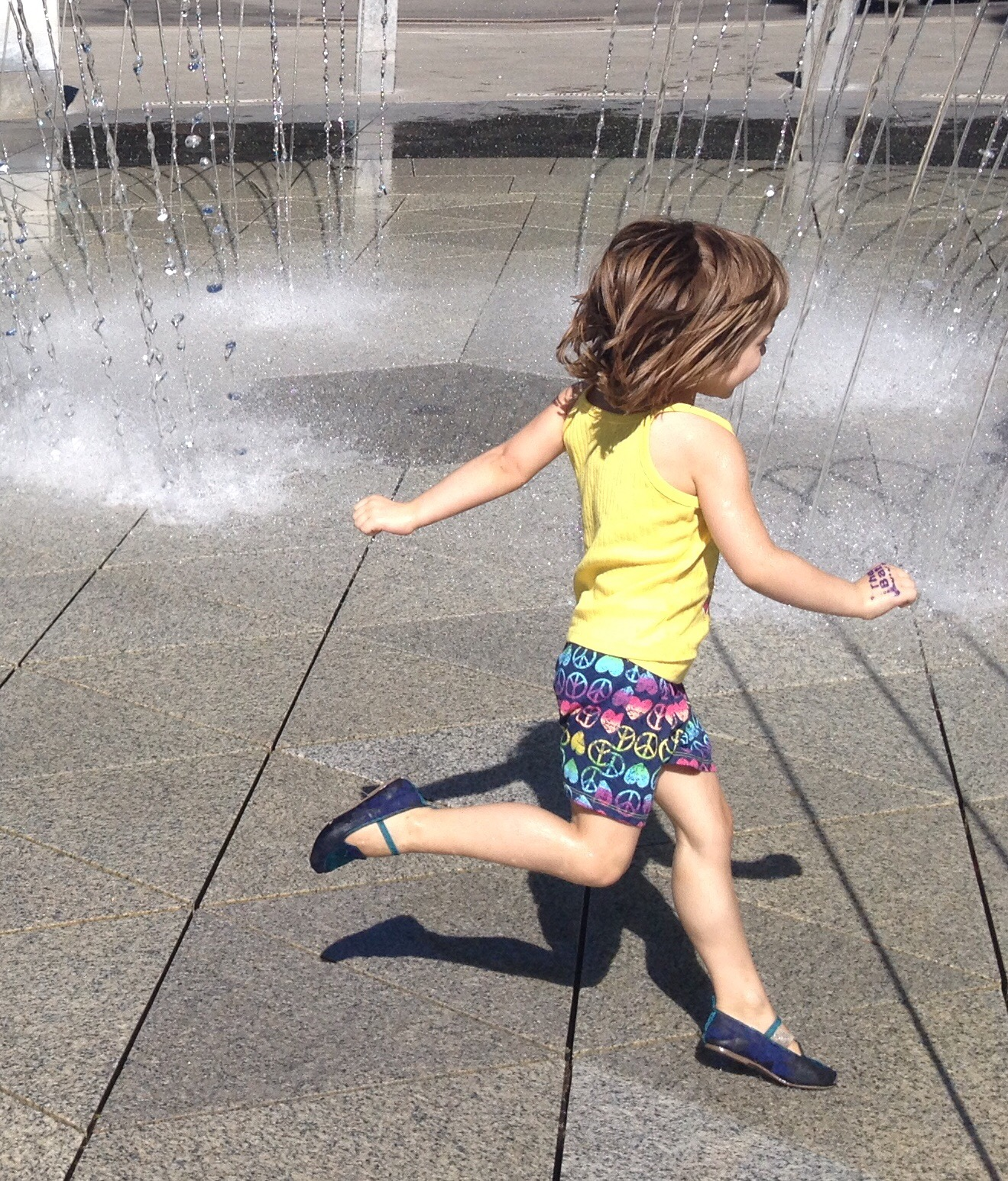 This photo is of my youngest daughter running through a water feature at an amusement park and have yet to paint it. It makes me so happy. See how this photo fits the bill for a great image to use as a reference for art.