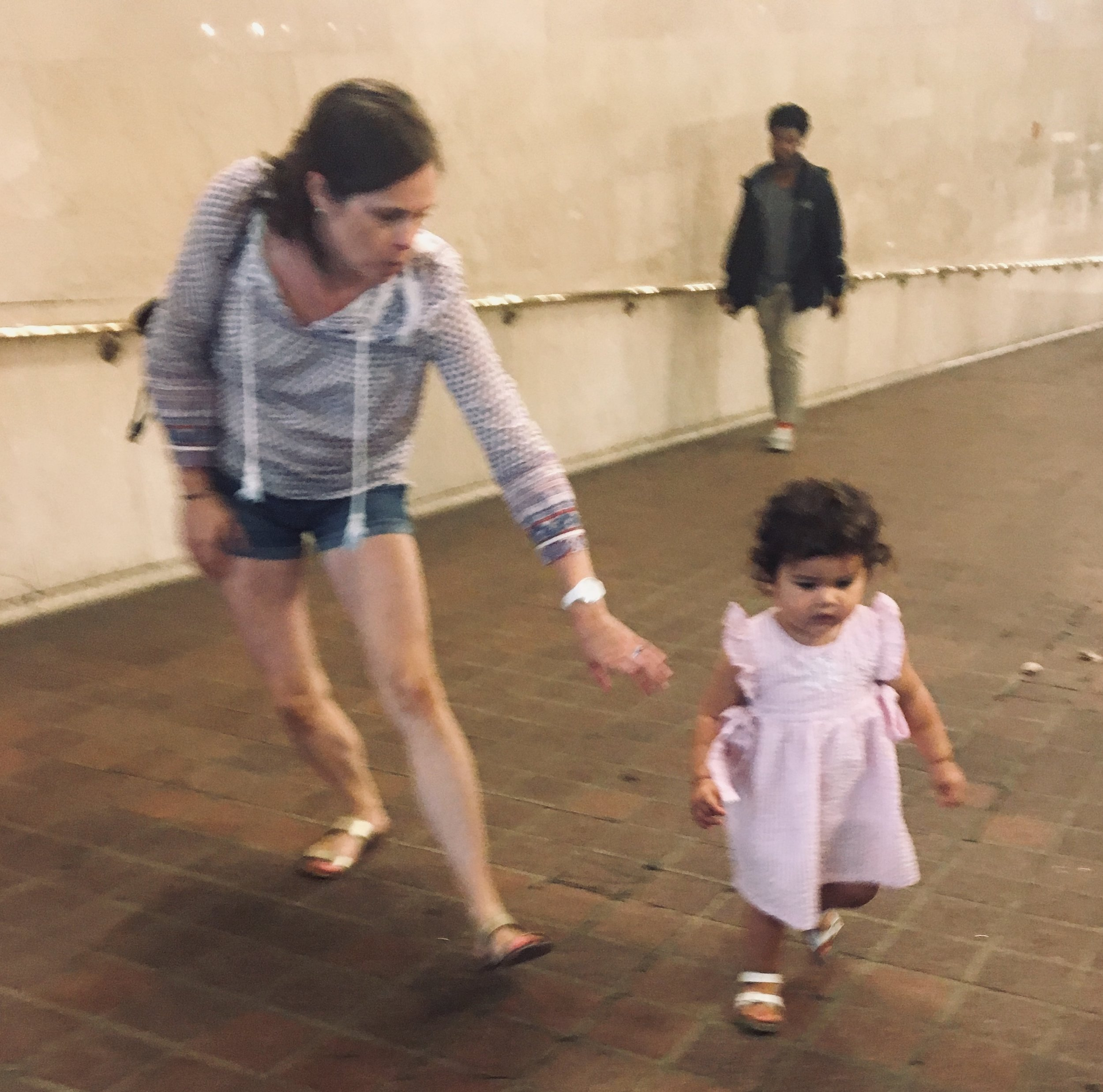 Snapped this shot while people watching in Grand Central Station, NYC. I loved that extended arm and leg of the mom to the toddler who just wants to walk this way.
