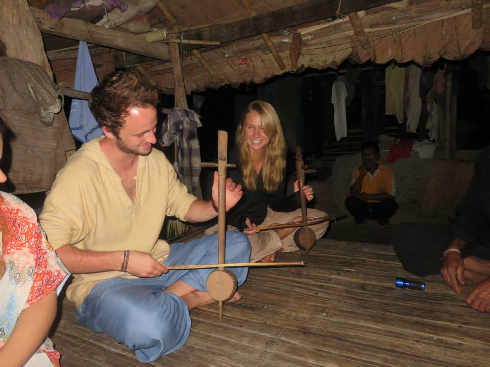 Playing music with a local tribe on a trek in Thailand