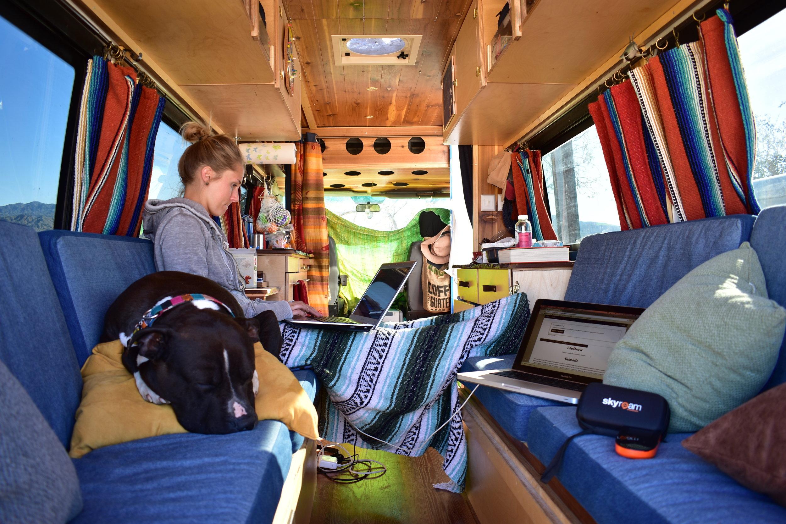 Digital nomads working in the van.