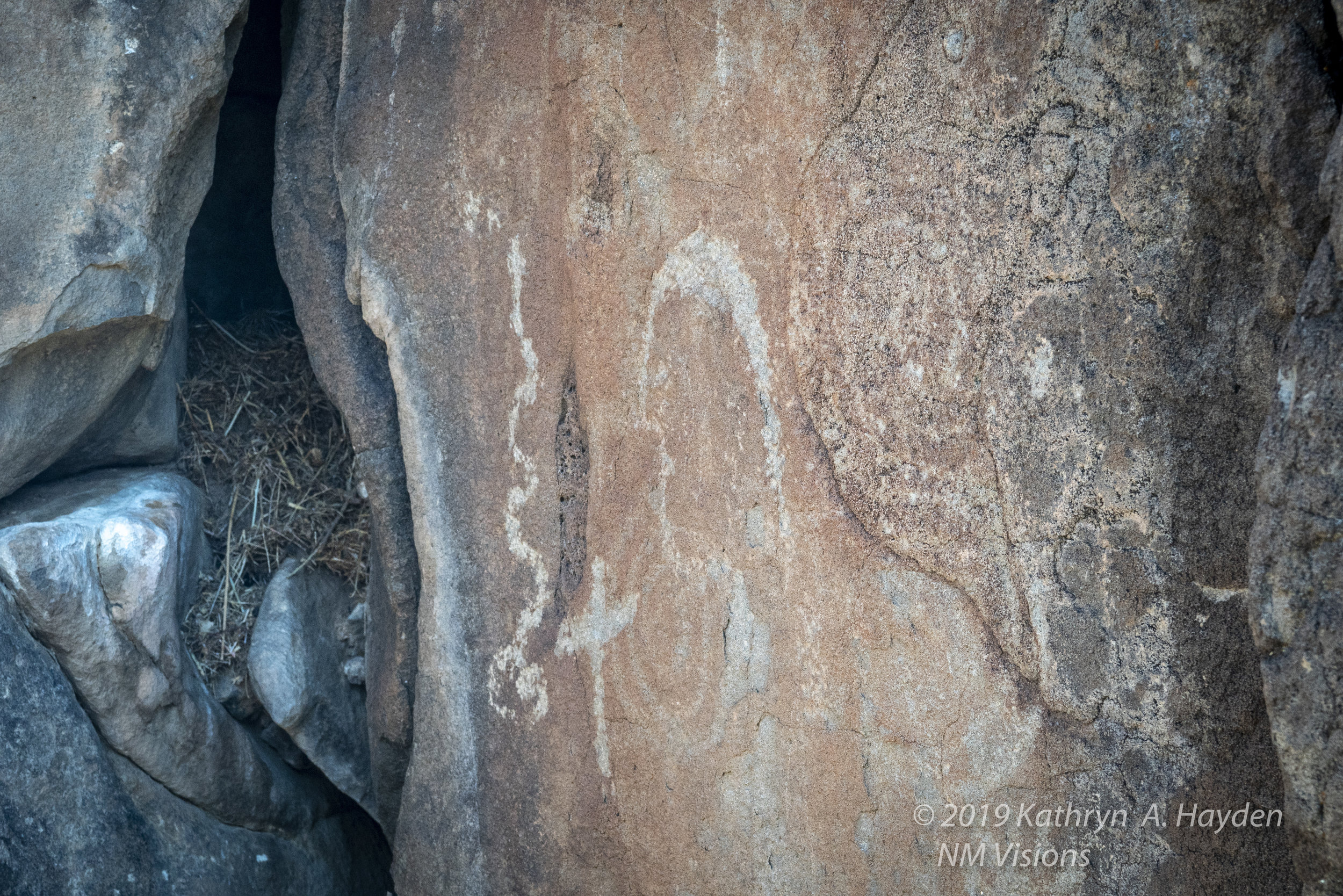 The shepherds would put crosses on some of the rocks with petroglyphs as counter to what they considered pagan art.  And can see the more modern residents have made the crevices their home
