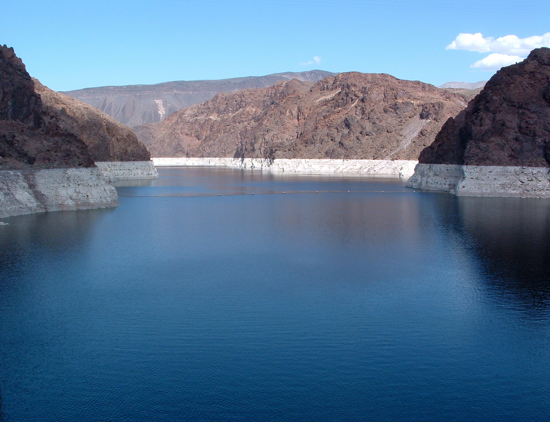 Lake Mead  is the largest reservoir in the United States, measured by water capacity. It is on the Colorado River about 24 mi (39 km) from the Las Vegas Strip.