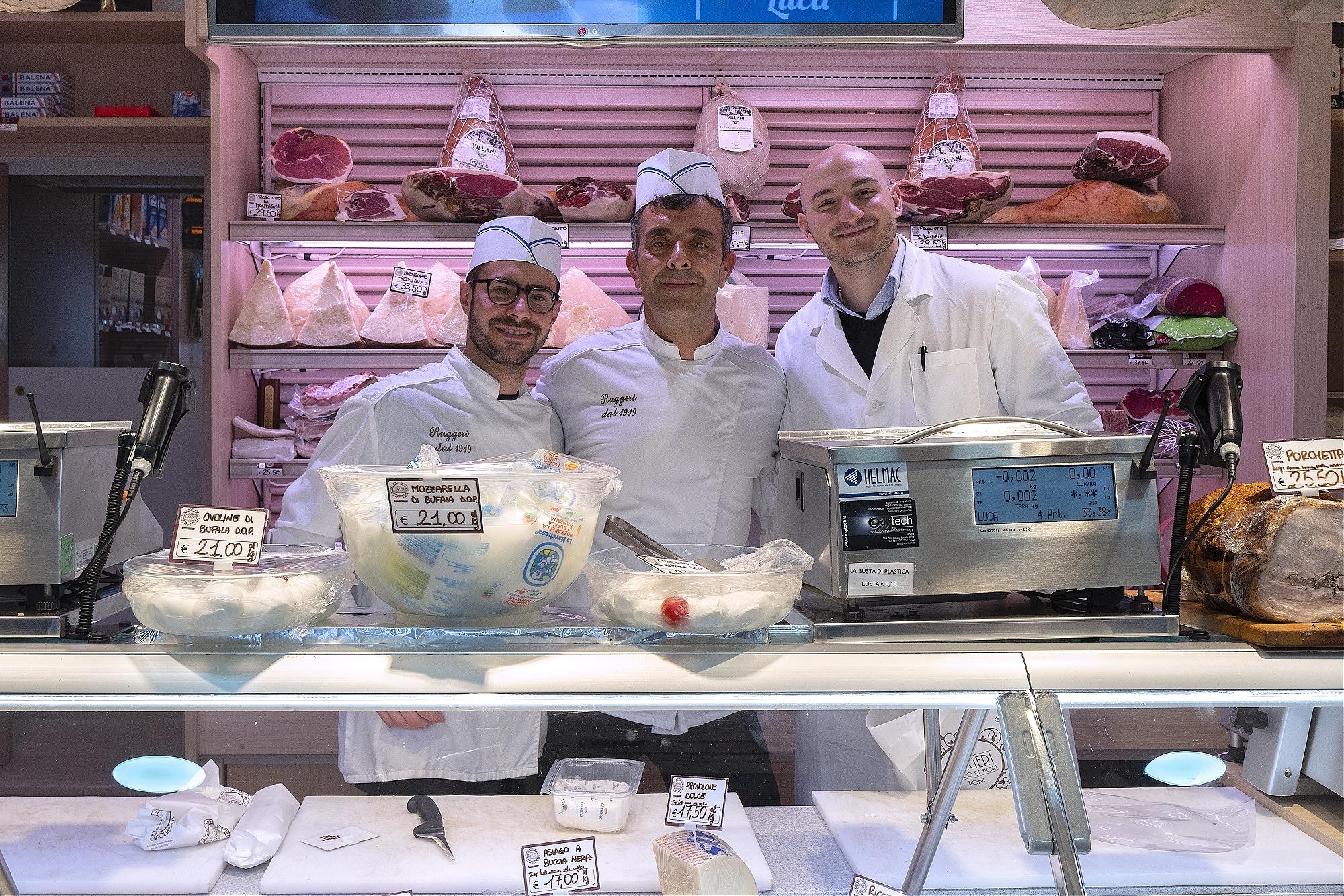 Delicatessen staff st Salsamenteria Ruggeri in Campo de Fiori, Rome