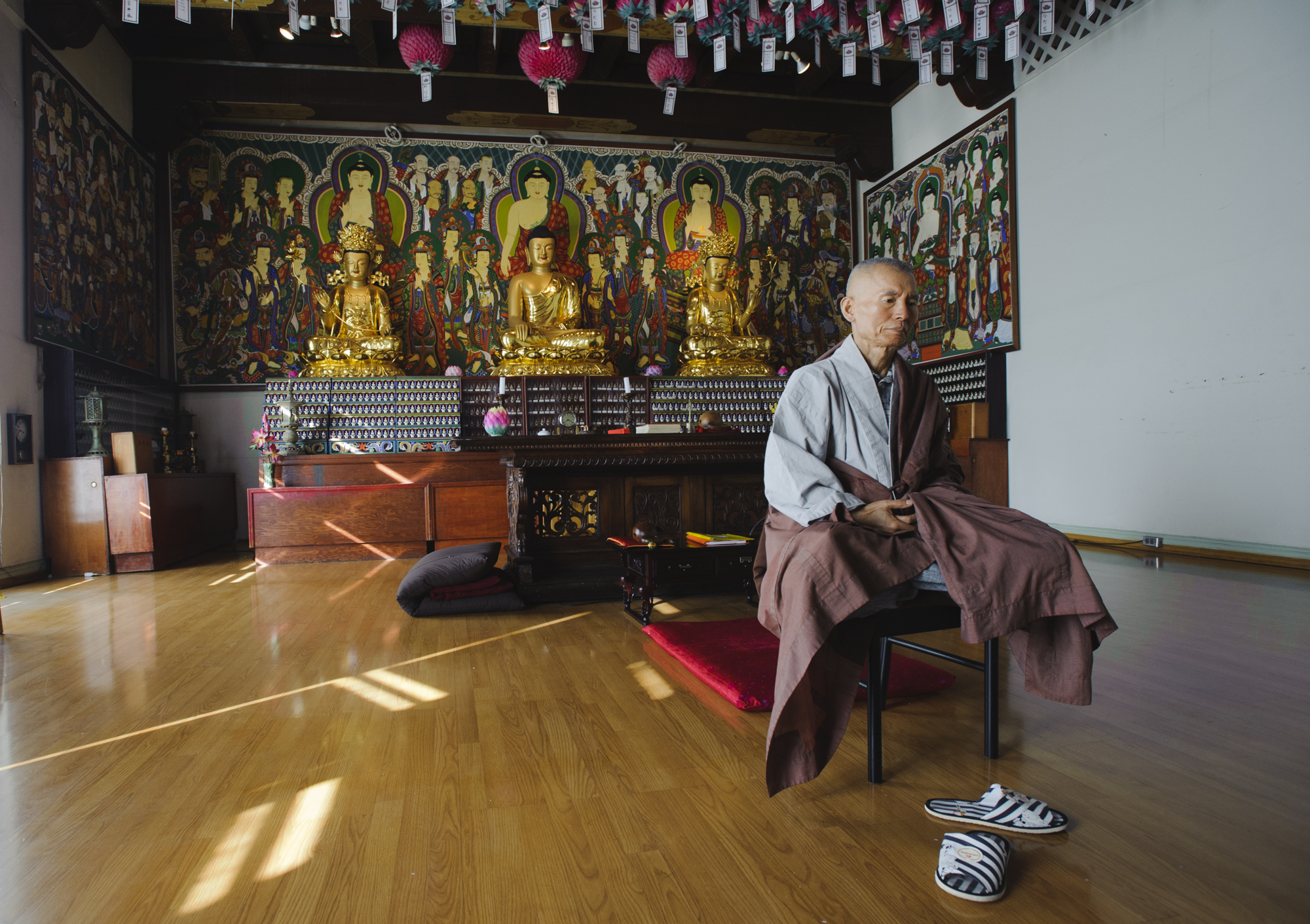 Meditation Master Daeryun poses for a portrait at the Korean Buddhist Culture Center on Oxford Avenue and 3rd Street. He has taught meditation for 35 years and leads services at the center every Sunday as well as private services with individuals wanting meditation guidance.