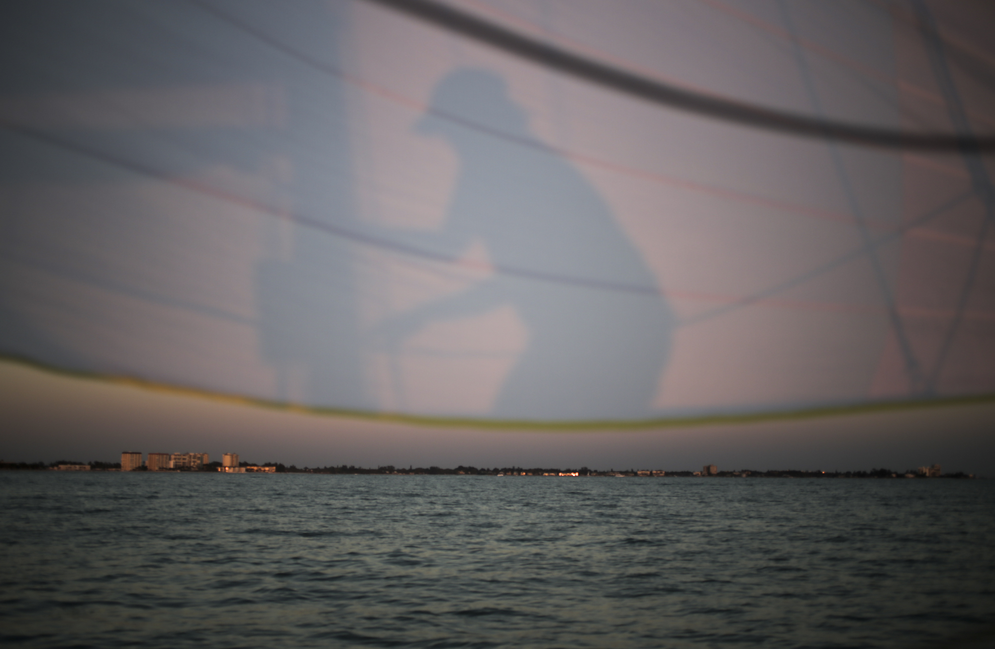 Dawn Narramore of Tampa adjusts the mast of the Mad Cow 2 as the sun sets over Long Boat Key, north of Sarasota, Friday, May 26, 2017. Narramore is originally from Wichita, Kansas and did not sail before she moved to Tampa about 20 years ago. She is now part of a seven person crew that sailed a 24-hour, 100-mile competition from Egmont Key to Fort Meyers.