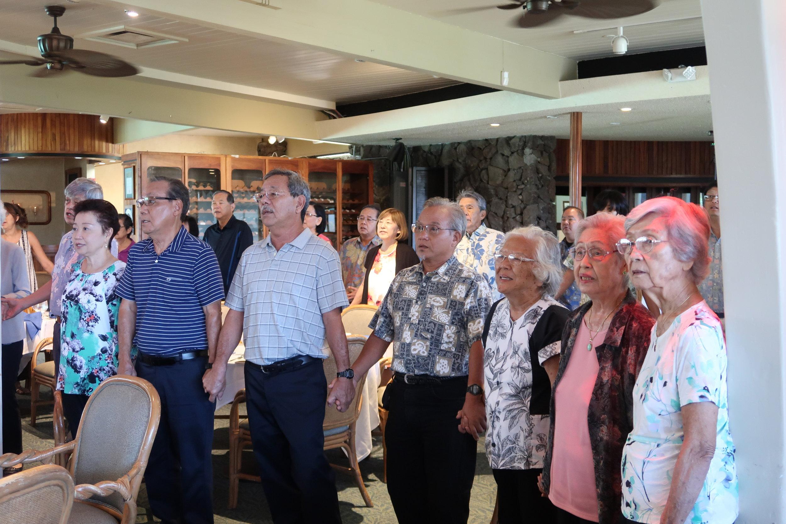 Before departing, we joined hands and sang Hawai'i Aloha