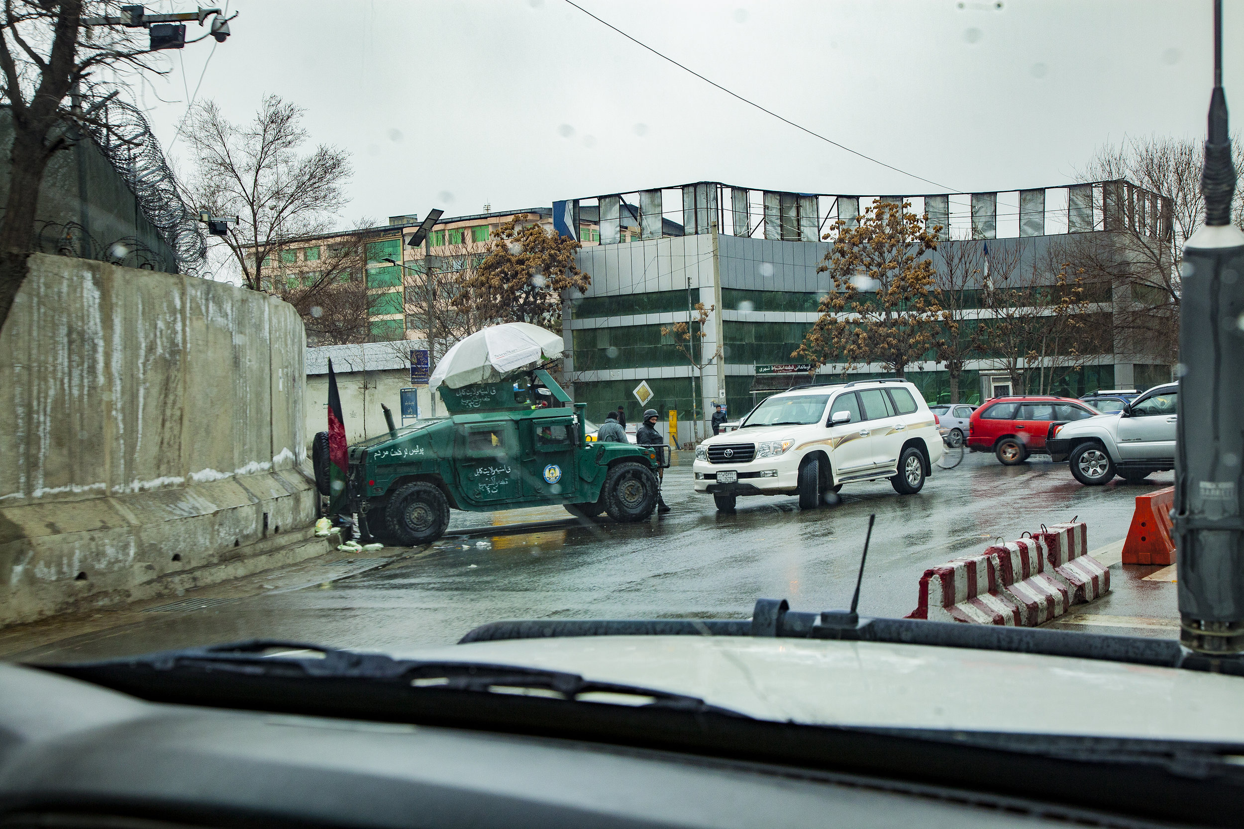 A typical sight in Kabul: armoured vehicles; blast walls and Army checkpoints.