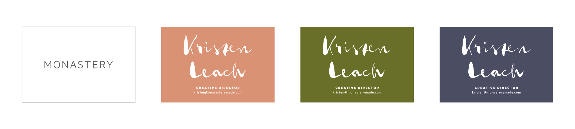 Business cards made with the three primary brand colors