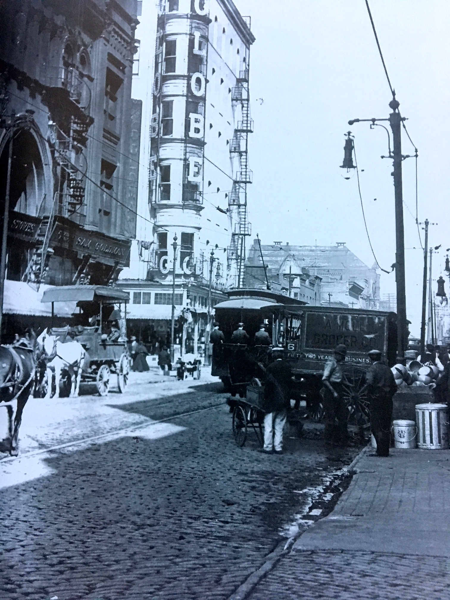 """7th Street looking north across Franklin Avenue, ca. 1900. The Globe Theater at 719 Franklin Ave and St. Patrick's School and Hall are in the background - photo source: """"Capturing the City"""""""