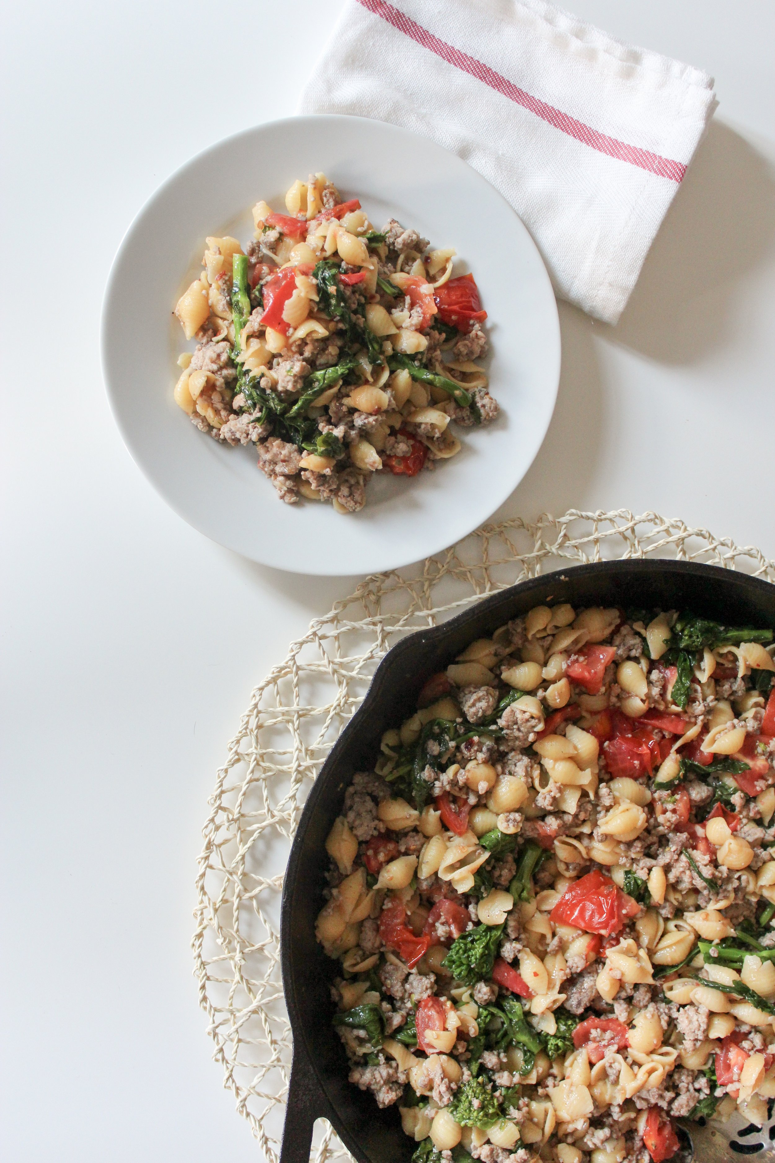 Fresh broccoli rabe and sweet tomatoes add color and flavor to this pork pasta dish.