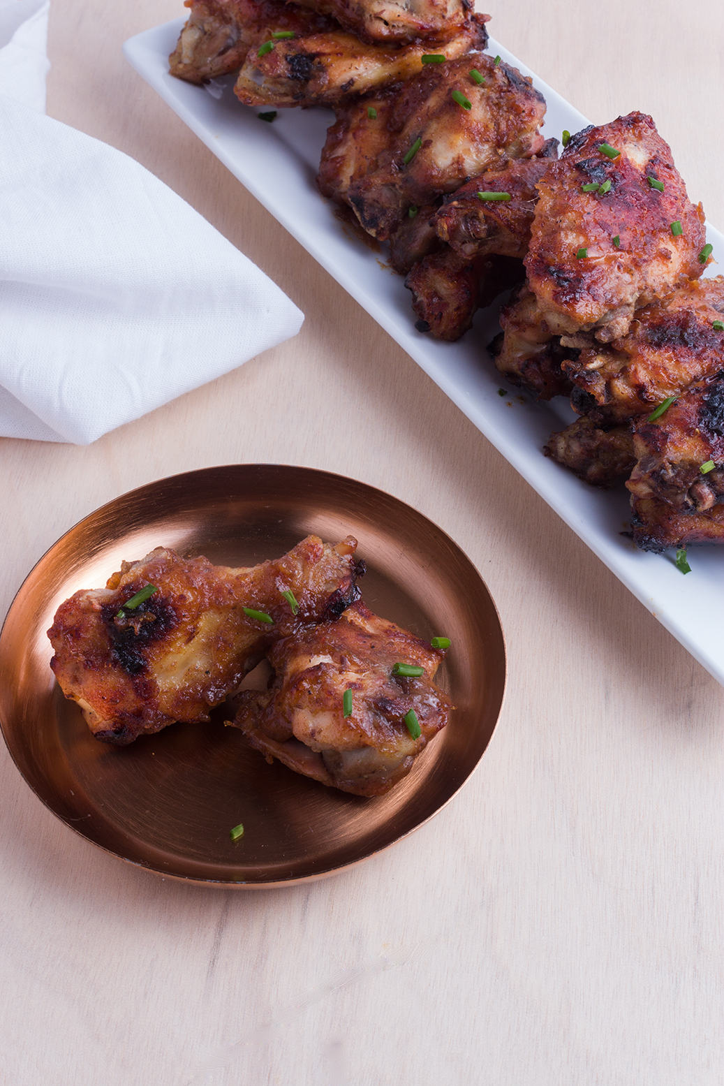 Don't sacrifice flavor when making healthier wings for your next tailgate, try these Bourbon Orange Chicken Wings.