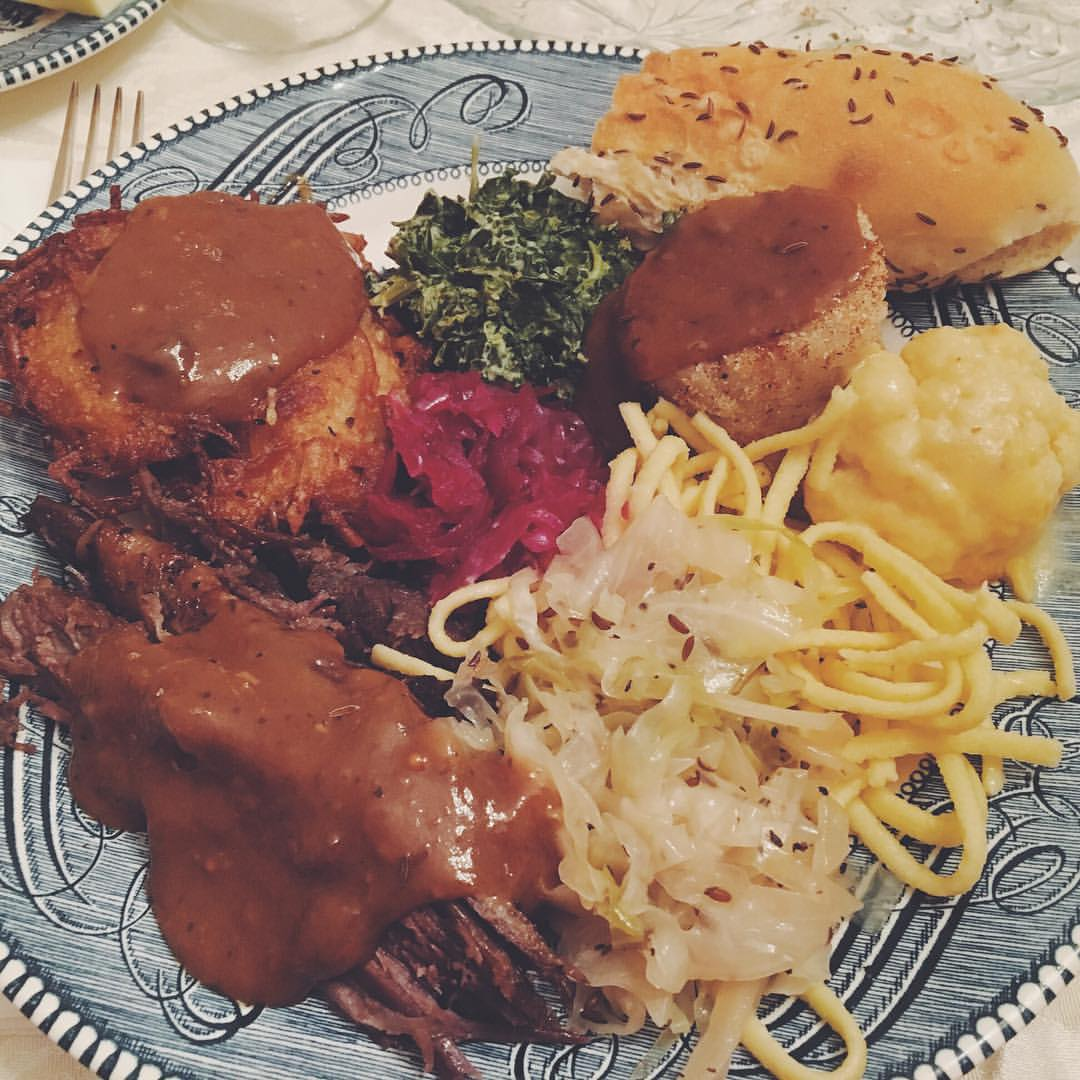 A big plate of love. Sauerbraten, sweet & sour cabbage, red cabbage, spatzle, latke, creamed spinach, potato dumplings, baked cauliflower.