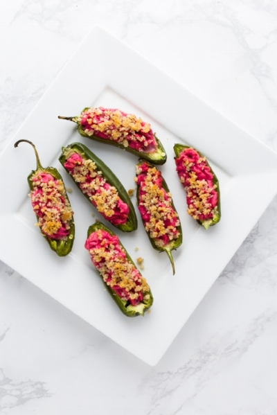 Bright and festive, these baked Cranberry & Goat Cheese Stuffed Jalapeños Peppers are perfect for your holiday get together.