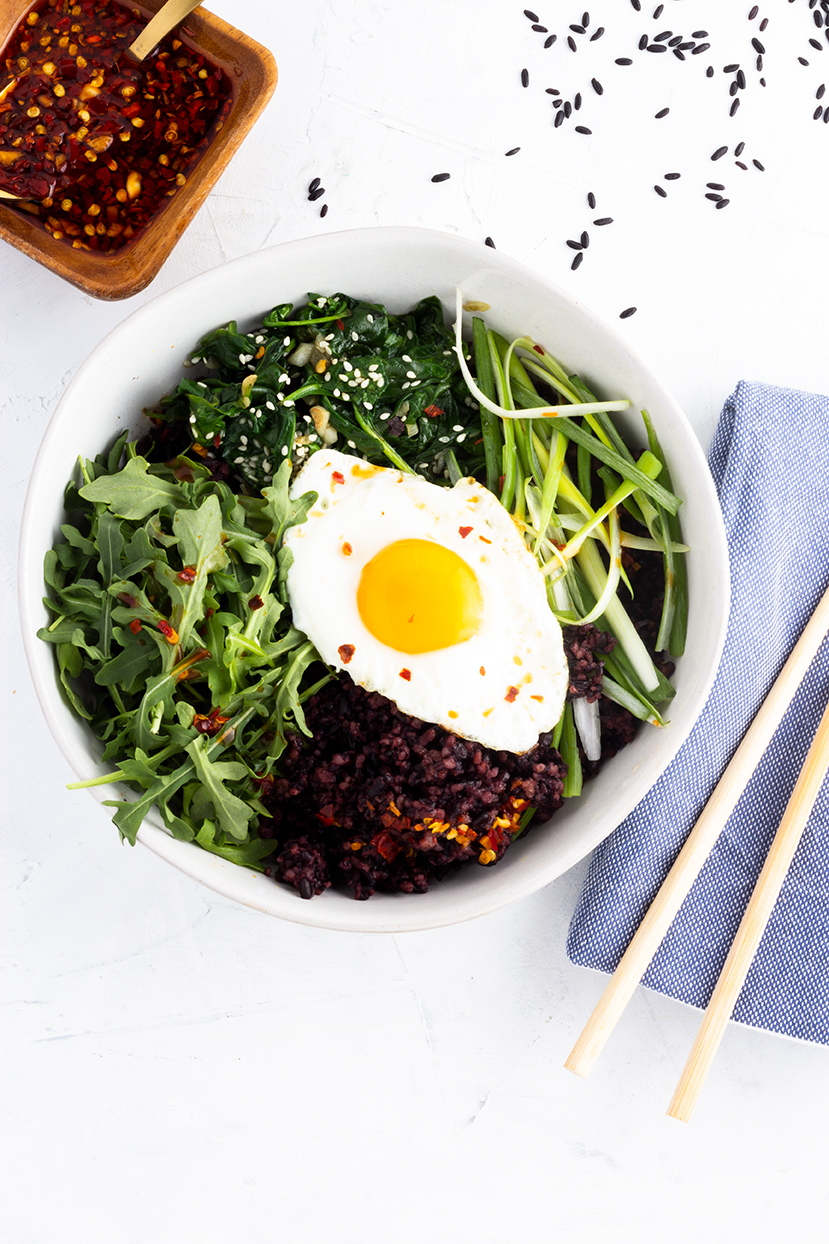 A seasonal dish packed with greens, forbidden rice and a spicy red chili sauce, this Spring Greens Bibimbap is perfect for tasty weeknight meals!